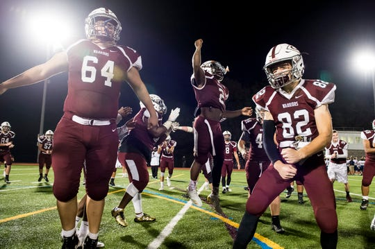 The Gettysburg Warriors celebrate following their 55-21 win over Eastern York on Friday, September 28, 2018.