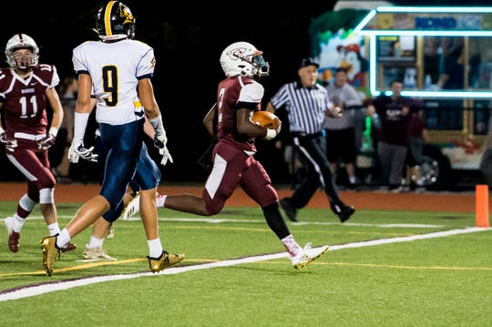 Gettysburg's Ammon Robinson runs into the end zone to score a touchdown against Eastern York on Friday, September 28, 2018.