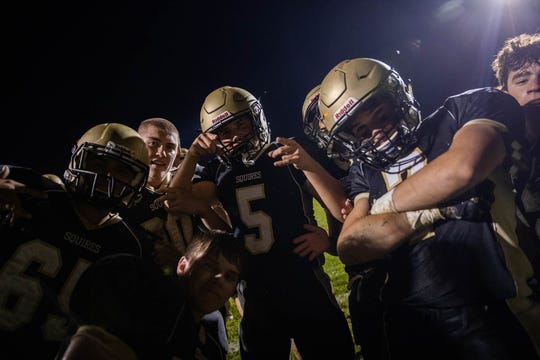 Delone Catholic players celebrate after winning a game against Biglerville, Friday, Sept. 28, 2018, in McSherrystown. The Delone Catholic Squires defeated the Biglerville Canners 56-0.