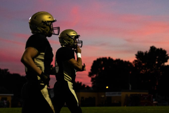 Delone Catholic players, including Delone's Logan Brown (9), left, exit the field after Brown scored a touchdown during the first half of a football game between Delone Catholic and Biglerville, Friday, Sept. 28, 2018, in McSherrystown. Delone led Biglerville 35-0 at the half.