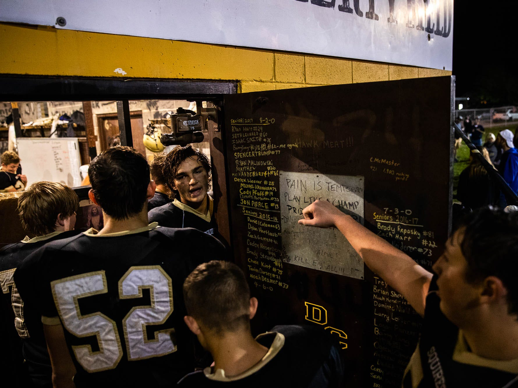 Delone Catholic players bang on the lockerroom door after winning a game against Biglerville, Friday, Sept. 28, 2018, in McSherrystown. The Delone Catholic Squires defeated the Biglerville Canners 56-0.