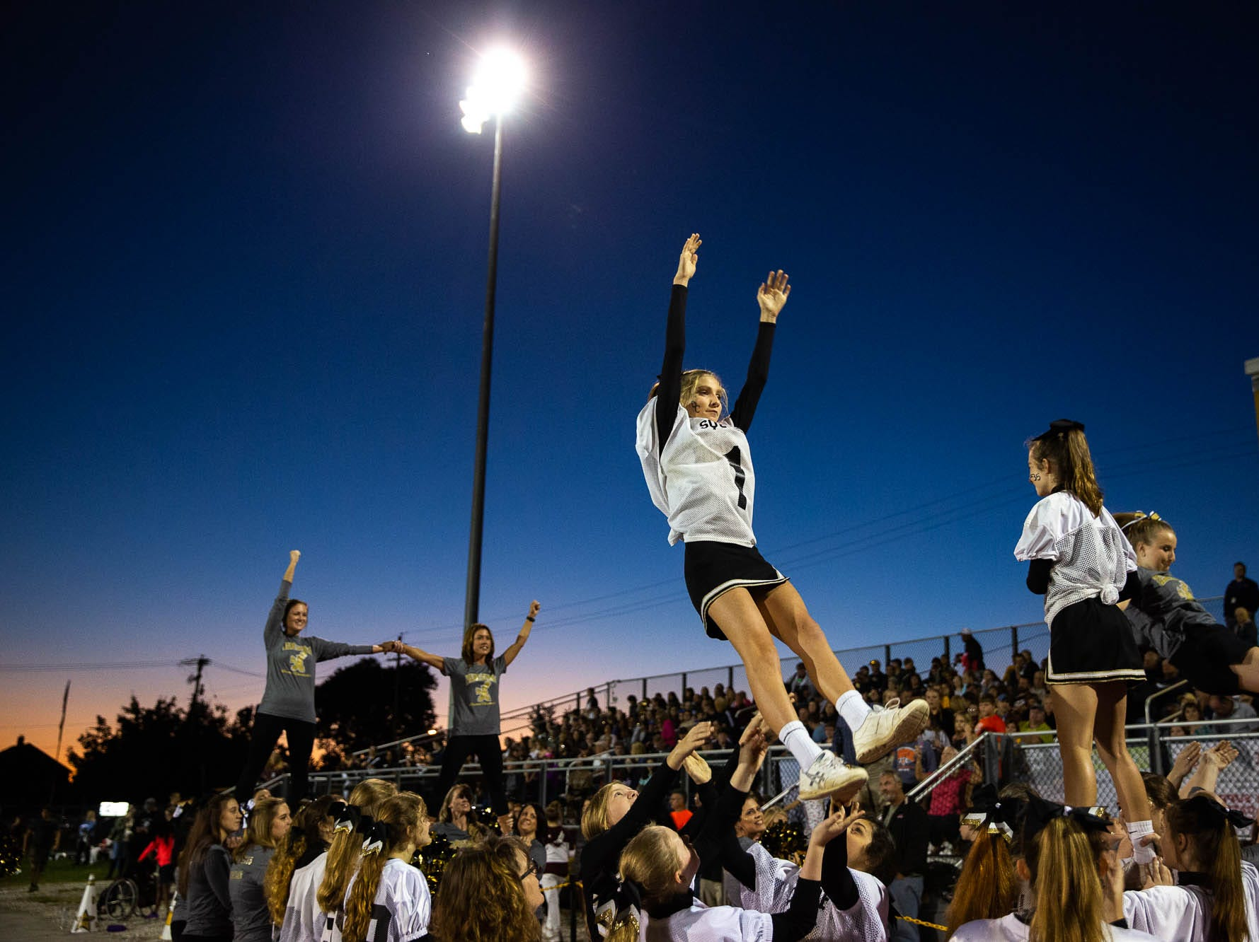 Delone Catholic cheerleaders cheer during the first half of a football game between Delone Catholic and Biglerville, Friday, Sept. 28, 2018, in McSherrystown. Delone led Biglerville 35-0 at the half.