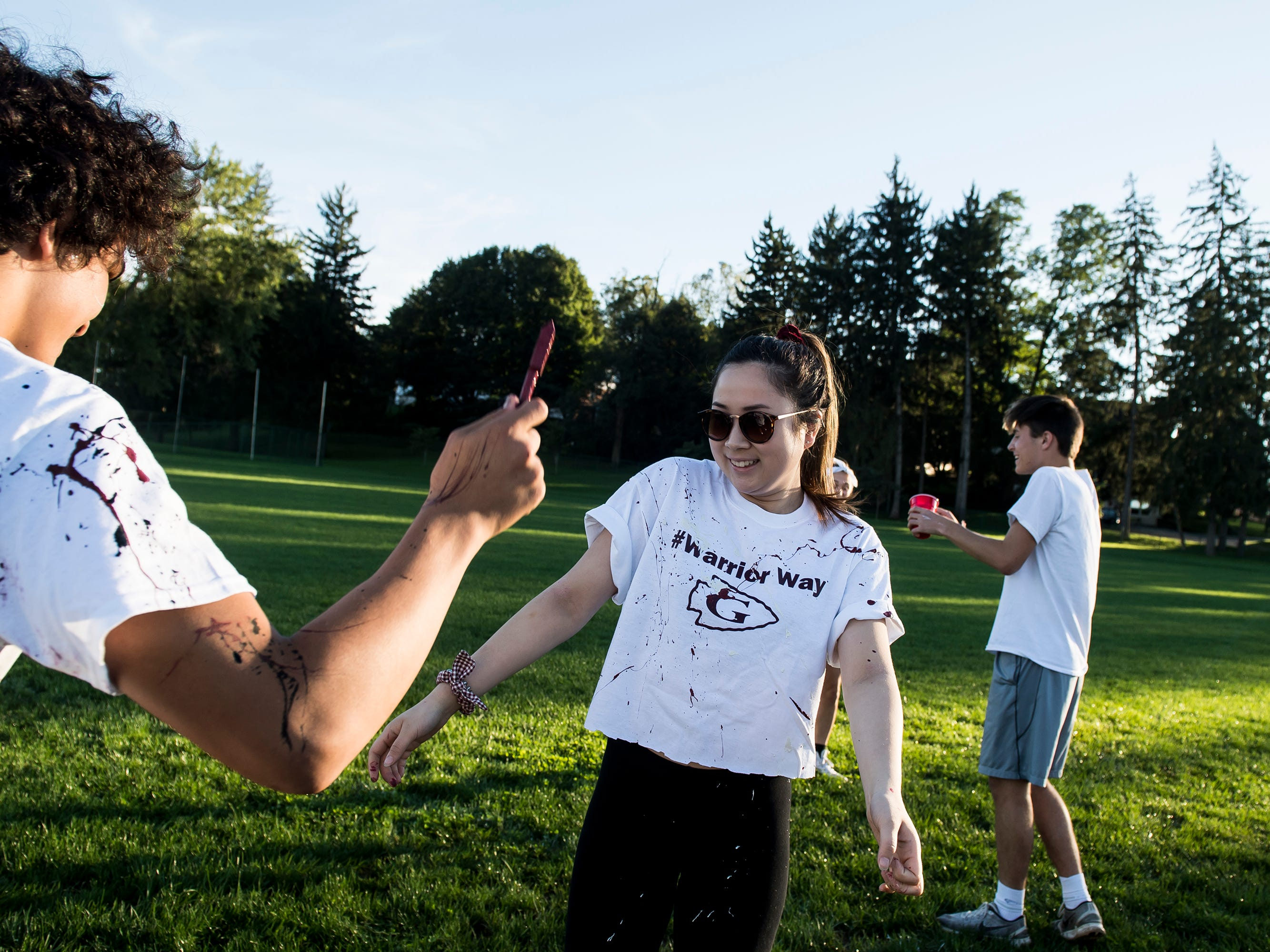 """Gettysburg student Sarah Haung gets paint thrown at her by John Halbrendt during a """"splatter-fest"""" prior to the football game against Eastern York on Friday, September 28, 2018. The fest helped raise money for the school's Mini-THON."""