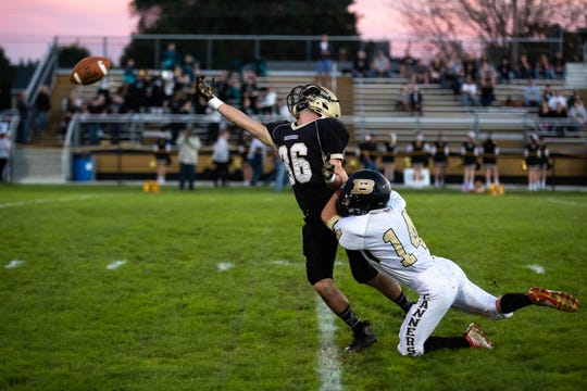 Delone's Ryan Myers (36) is taken down by Biglerville's Aaron Stremmel (14) during the first half of a football game between Delone Catholic and Biglerville, Friday, Sept. 28, 2018, in McSherrystown. Delone led Biglerville 35-0 at the half.