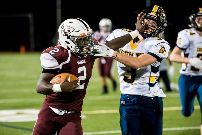 Gettysburg's Ammon Robinson (2) stiff-arms Eastern York's Dylan Zurin on Friday, September 28, 2018. Robinson racked up 155 rushing yards, five touchdowns and one interception.