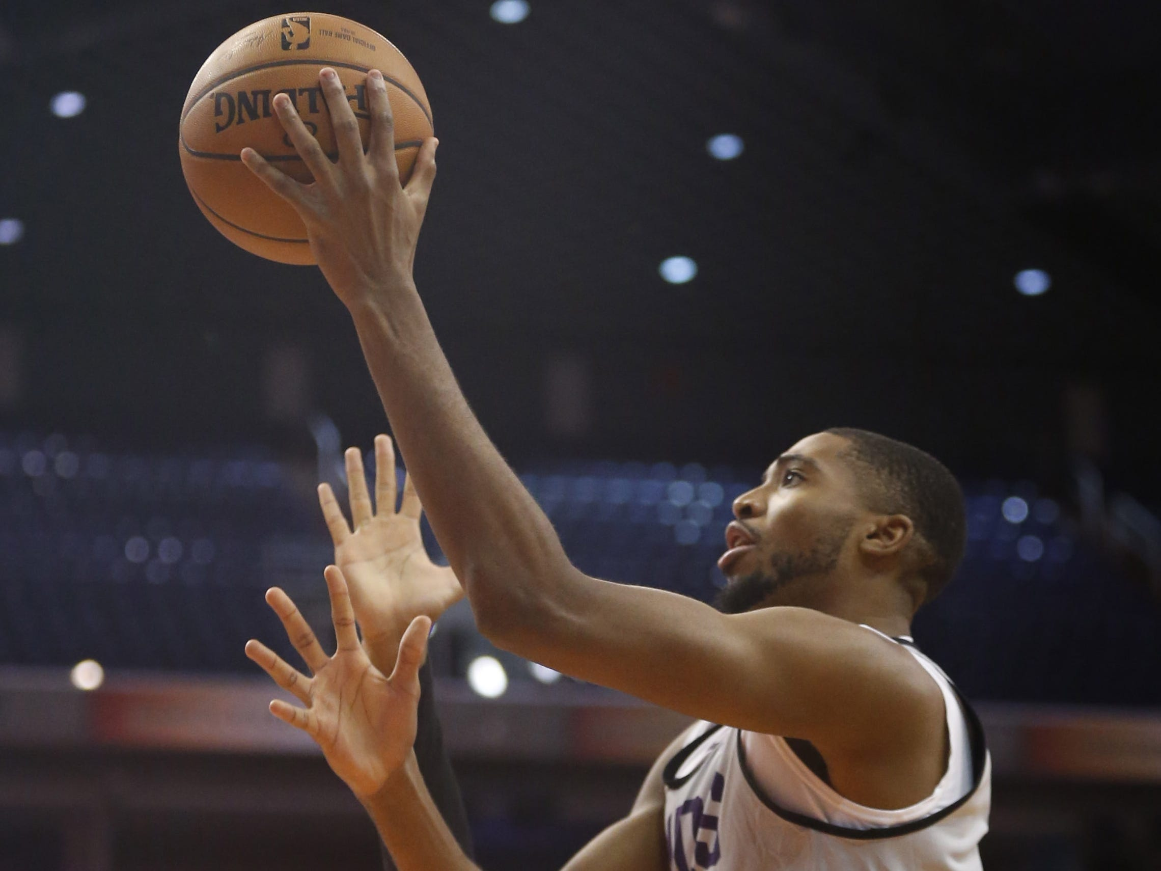 Suns Mikal Bridges shoots against Ellie Okobo during an Open Practice at Talking Stick Resort Arena in Phoenix, Ariz. on Sept. 29, 2018.