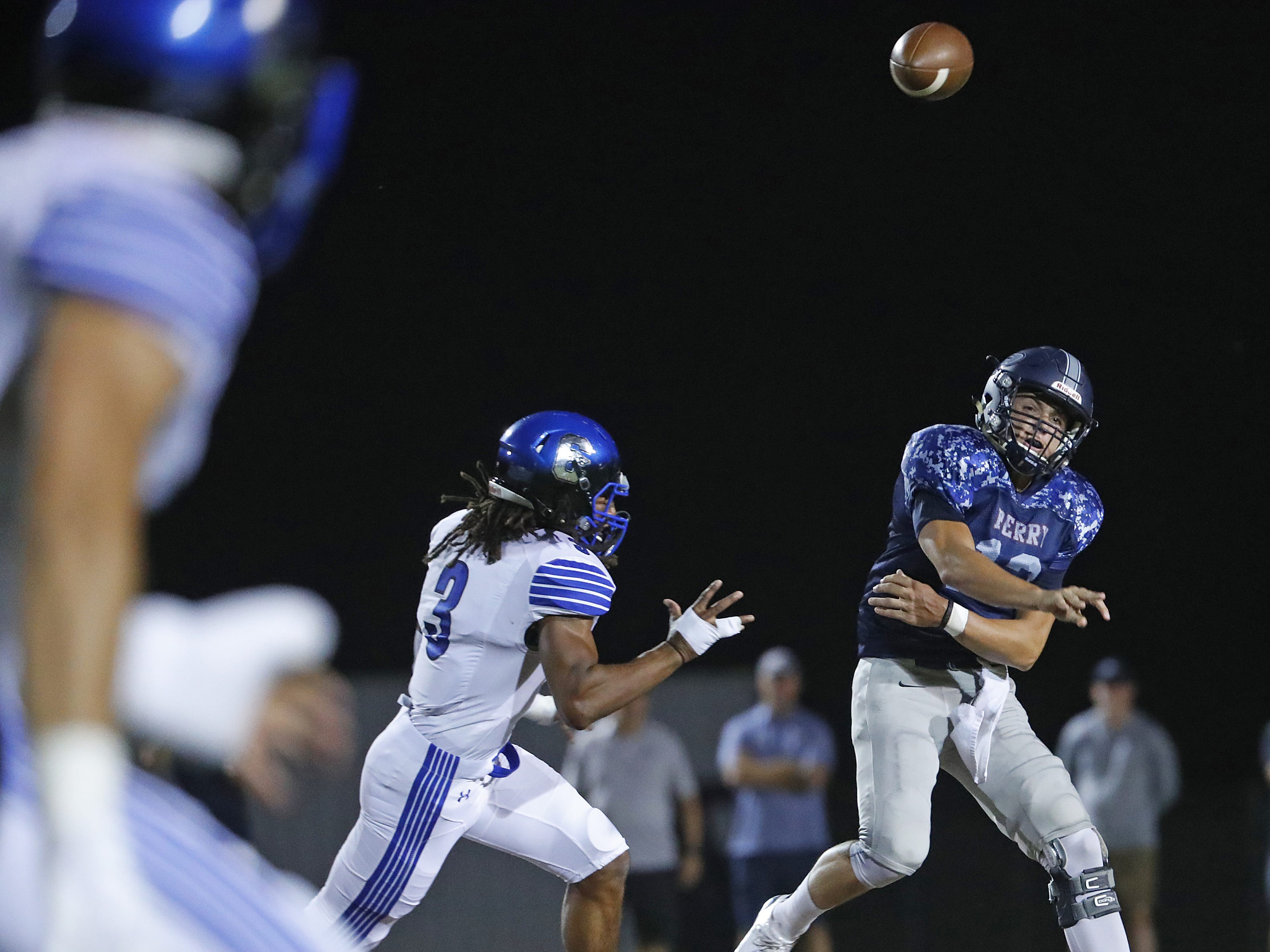 Perry's Chubba Purdy (12) throws a pass under pressure from Chandler's Malik Reed (3) at Perry High School in Gilbert, Ariz. on Sept. 28, 2018.  #azhsfb