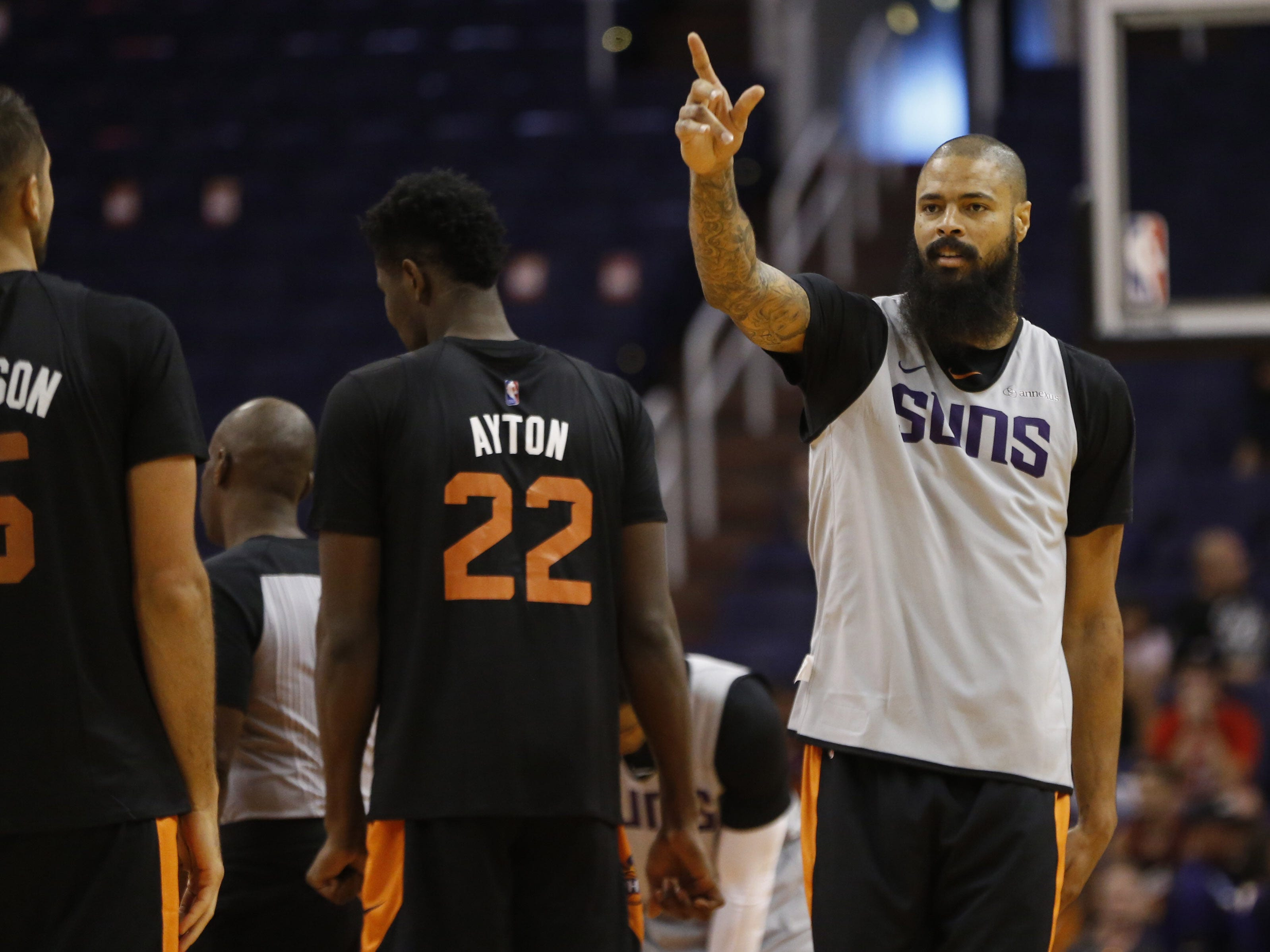Suns Tyson Chandler points to the crowd during an Open Practice at Talking Stick Resort Arena in Phoenix, Ariz. on Sept. 29, 2018.