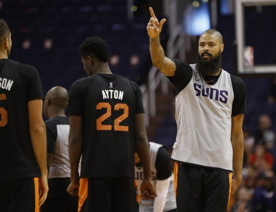Tyson Chandler points at the crowd at the Suns' open practice at Talking Stick Resort Arena on Sept. 29.