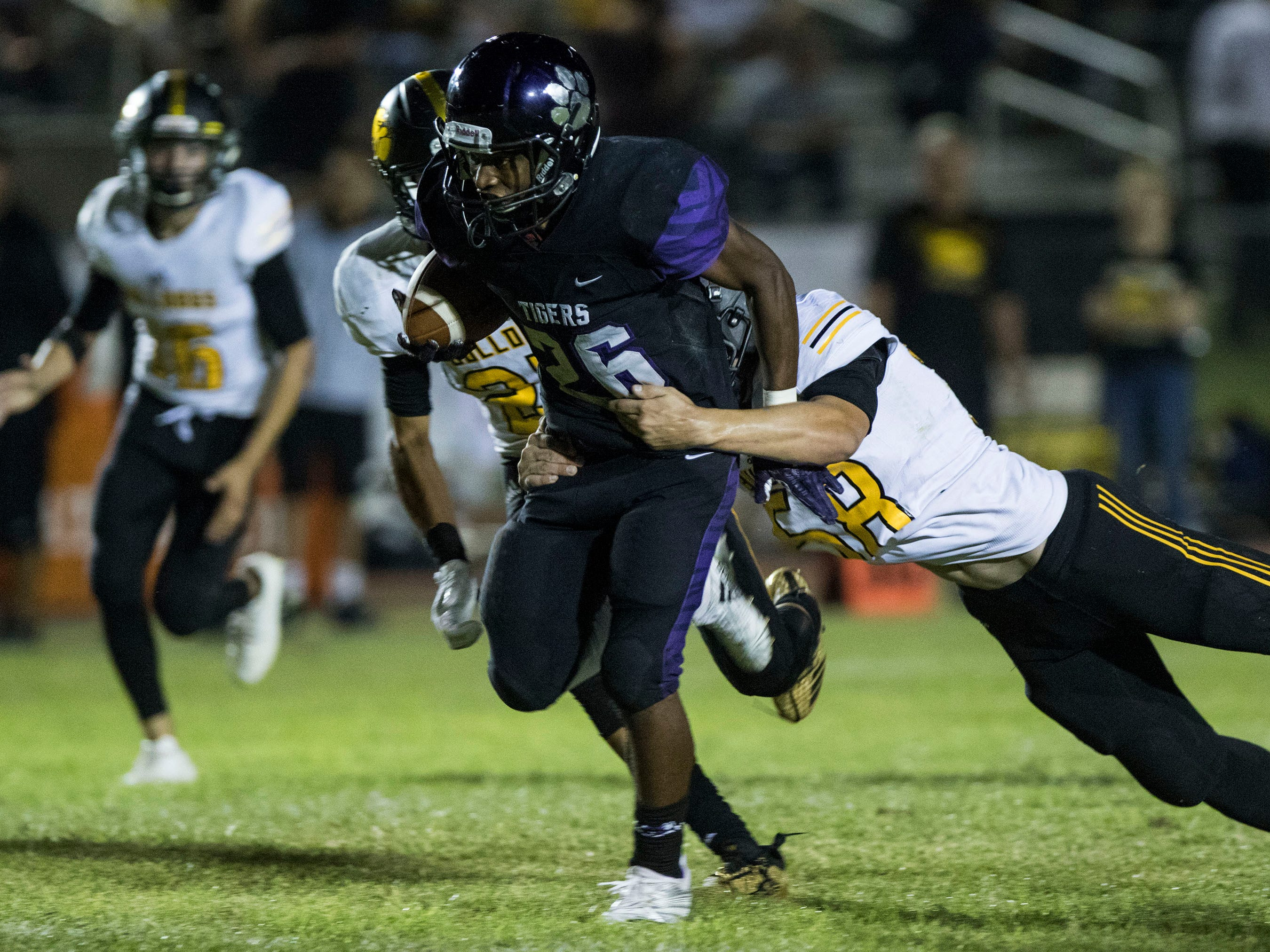 Millennium's Isaac Oliver breaks the tackle of a Goldwater player defense during their game in Goodyear Friday, Sept. 28, 2018. #azhsfb