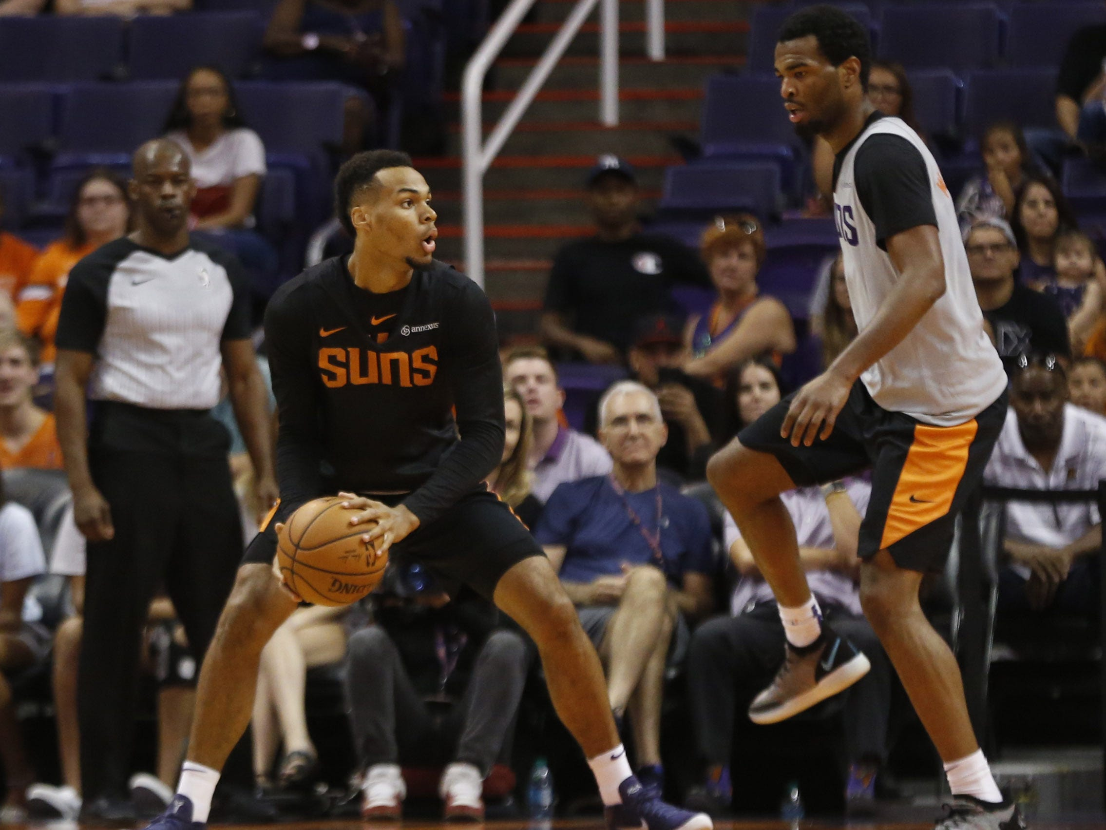 Suns Ellie Okobo looks for a teammate as TJ Warren defends him during an Open Practice at Talking Stick Resort Arena in Phoenix, Ariz. on Sept. 29, 2018.