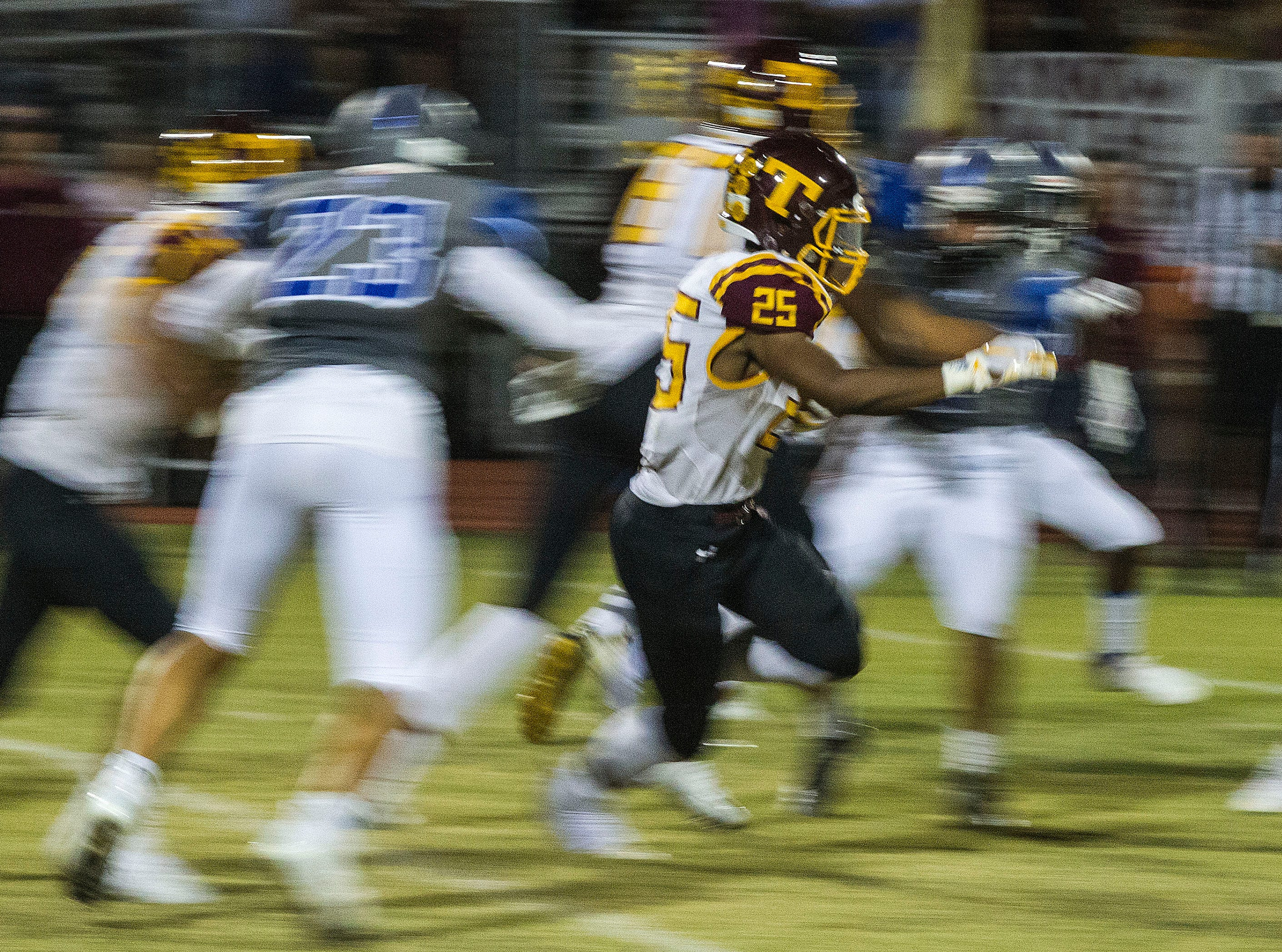 Tolleson's Arnell Christen Jr. runs up the middle during their game with Westview in Avondale Friday, Sept. 28, 2018. #azhsfb