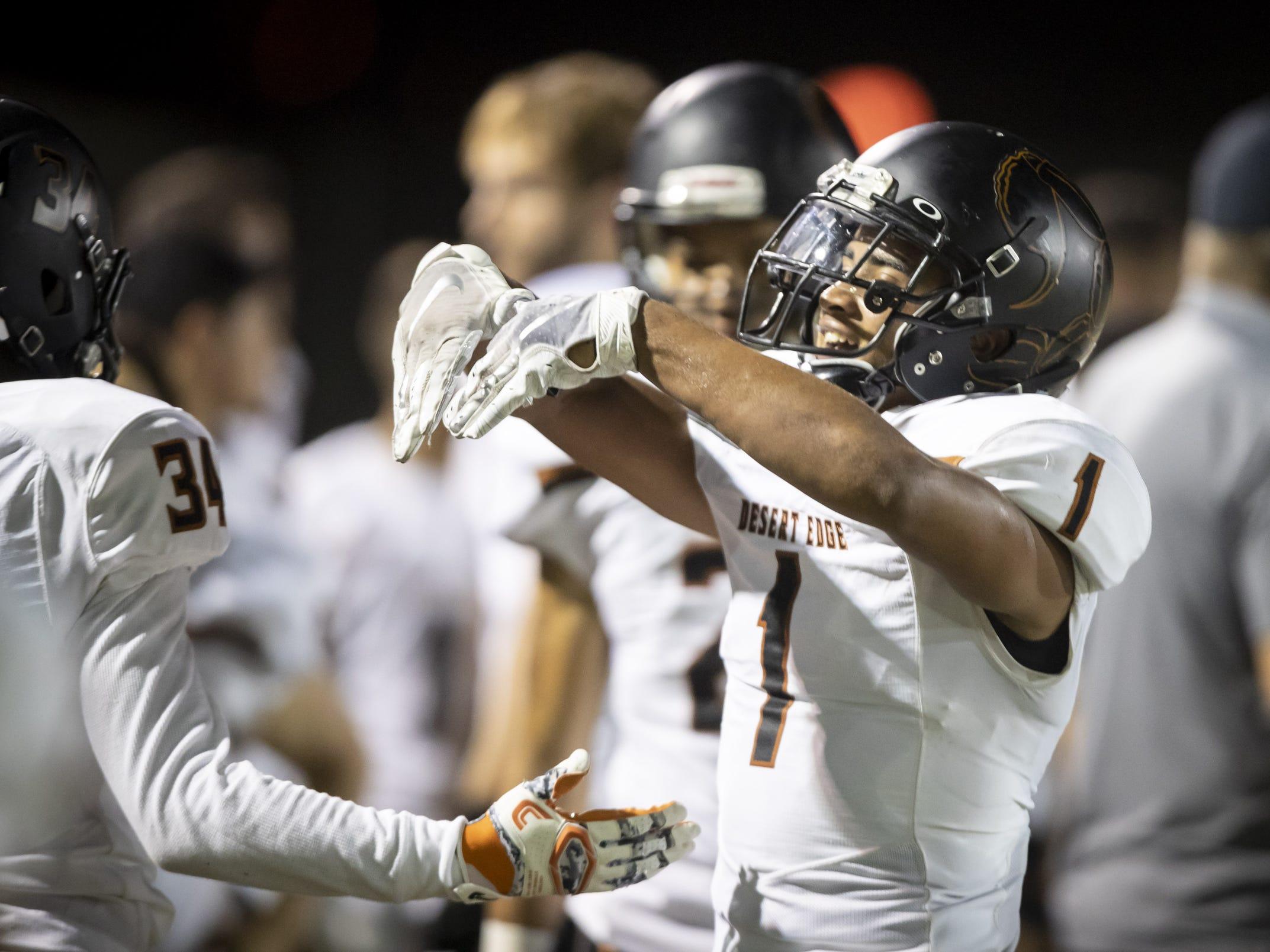 Sophomore free safety Steven Ortiz (1) of the Desert Edge Scorpions celebrates a touchdown against the Saguaro Sabercats at Saguaro High School on Friday, September 28, 2018 in Scottsdale, Arizona. #azhsfb