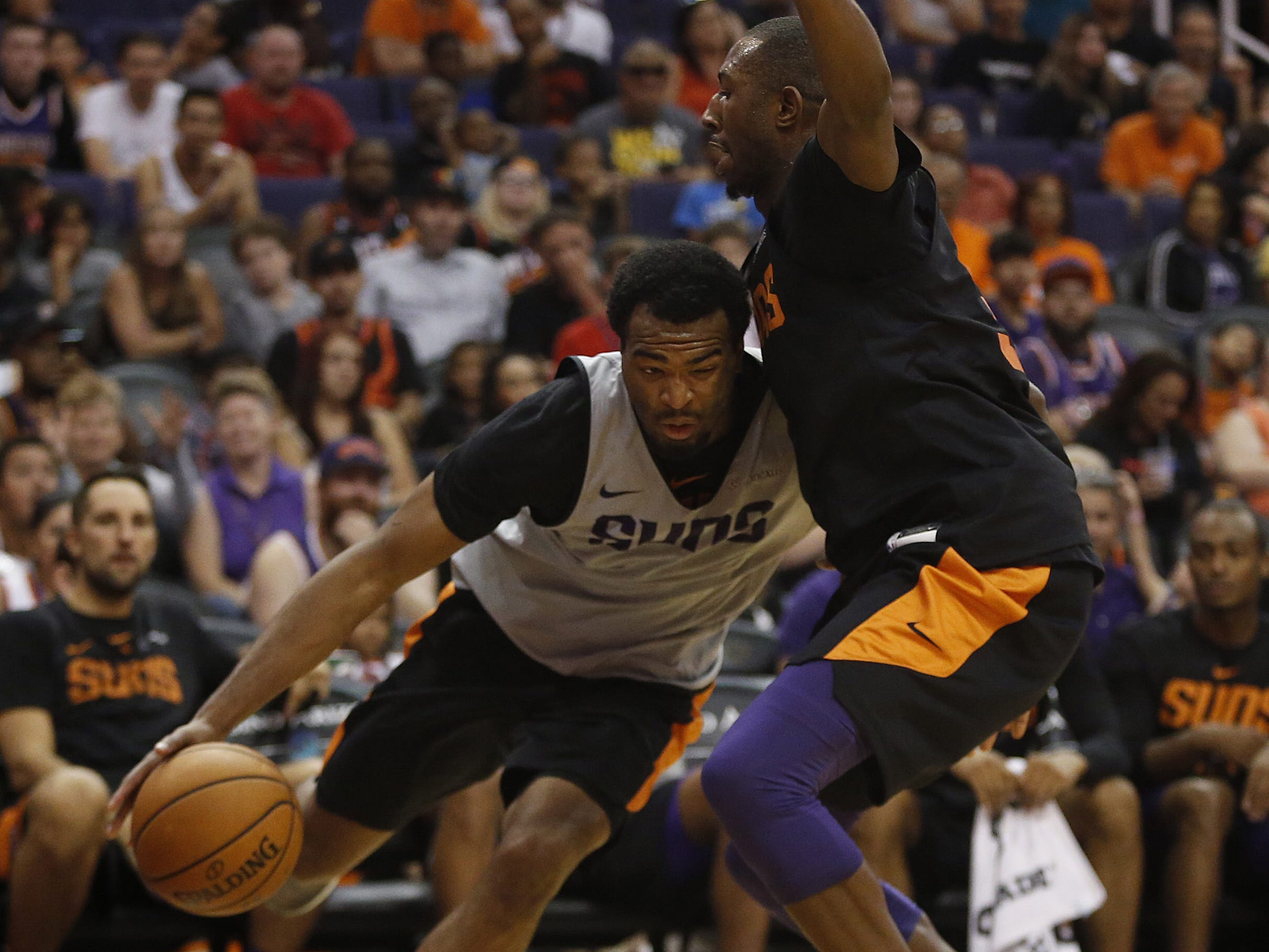 Suns TJ Warren drives against Davon Reed during an Open Practice at Talking Stick Resort Arena in Phoenix, Ariz. on Sept. 29, 2018.