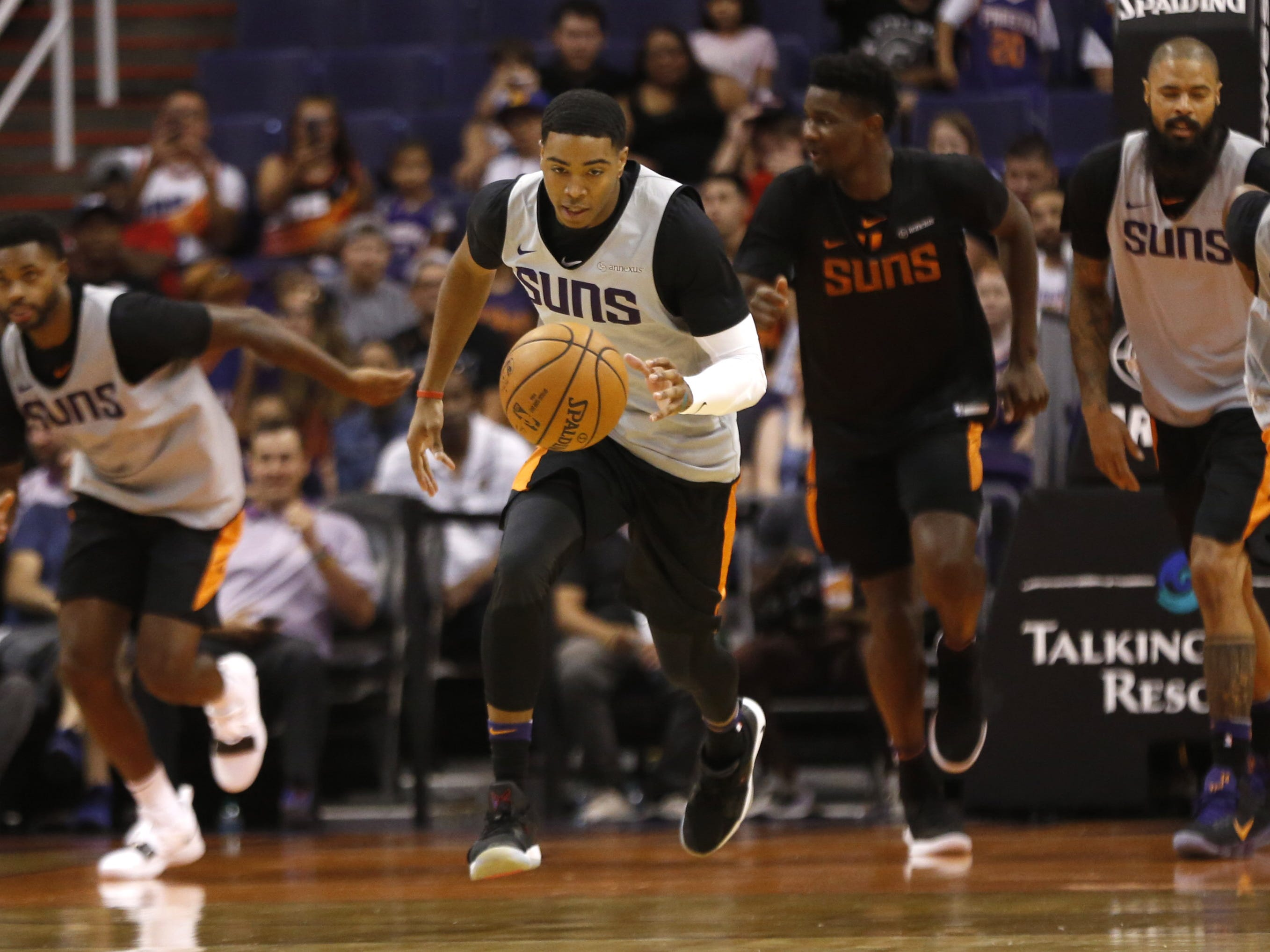 Suns Shaquille Harrison dribbles up court during an Open Practice at Talking Stick Resort Arena in Phoenix, Ariz. on Sept. 29, 2018.