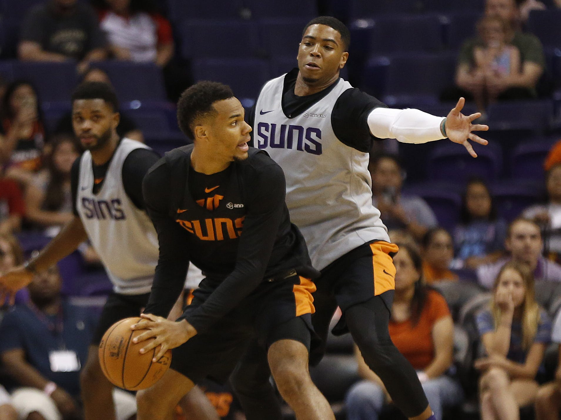 Suns Shaquille Harrison defends Ellie Okobo during an Open Practice at Talking Stick Resort Arena in Phoenix, Ariz. on Sept. 29, 2018.