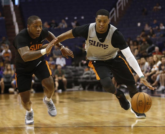 Suns Shaquille Harrison drives against Isaiah Canaan during an Open Practice at Talking Stick Resort Arena in Phoenix, Ariz. on Sept. 29, 2018.