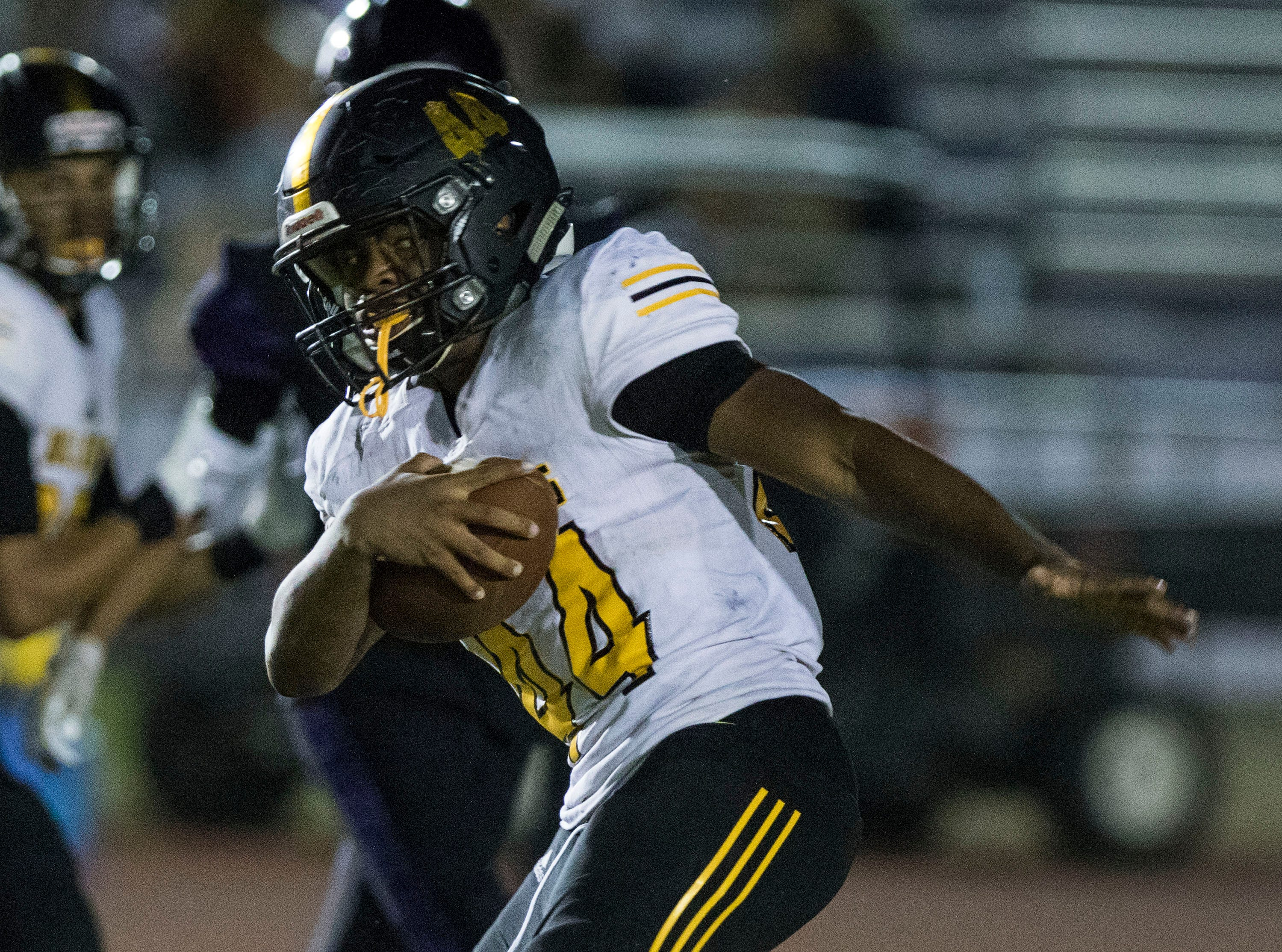 Goldwater's Marquise Corley tries to twist out of the tackle of a Millennium player during their game in Goodyear Friday, Sept. 28, 2018. #azhsfb