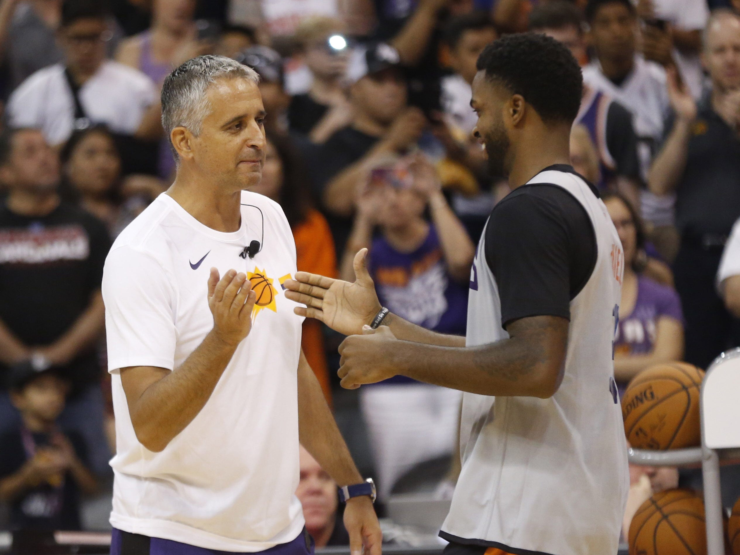 Suns head coach Igor Kokoškov high-fives Troy Daniels during an Open Practice at Talking Stick Resort Arena in Phoenix, Ariz. on Sept. 29, 2018.