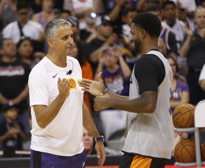 Suns head coach Igor Kokoškov high-fives Troy Daniels during an Open Practice at Talking Stick Resort Arena in Phoenix, Ariz. on Sept. 29, 2018.