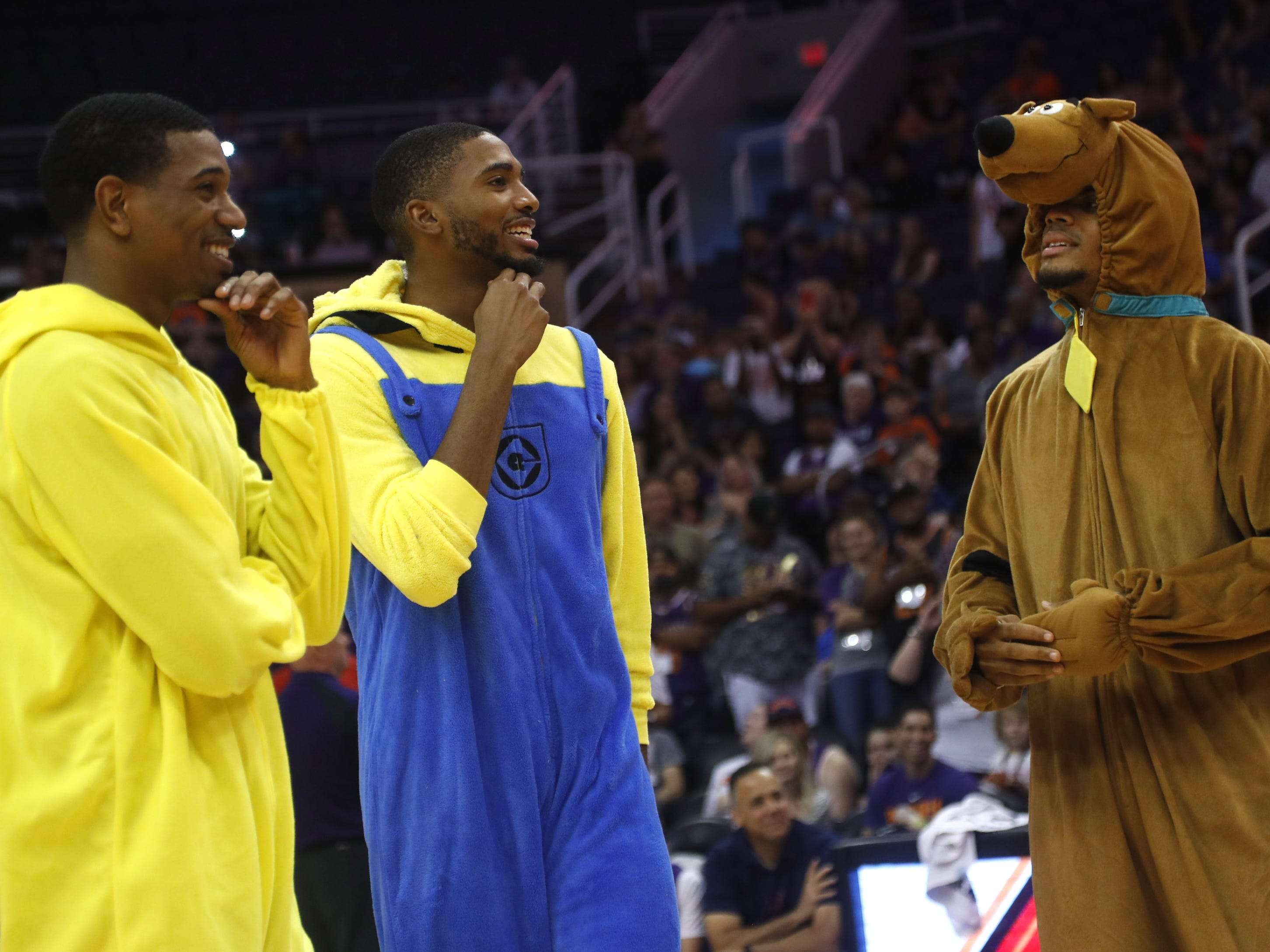 Suns De'Anthony Melton (L-R), Mikal Bridges and Elie Okobo wear costumes and wait for voting after their dance off during an Open Practice at Talking Stick Resort Arena in Phoenix, Ariz. on Sept. 29, 2018.