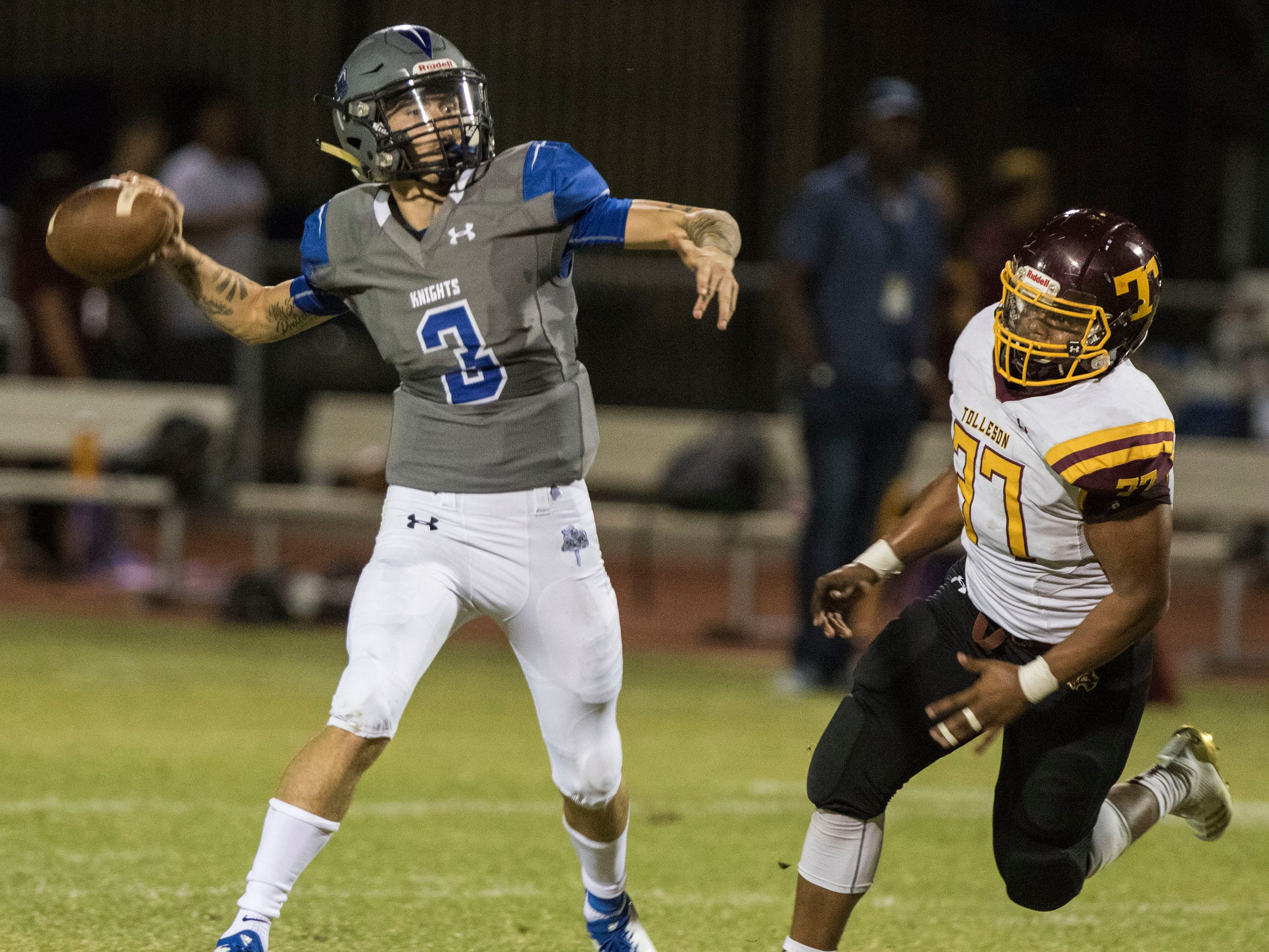 Westview's Chase Pope looks for a reciever as Tolleson's Nicholas Landing closes in on him during their game in Avondale Friday, Sept. 28, 2018. #azhsfb