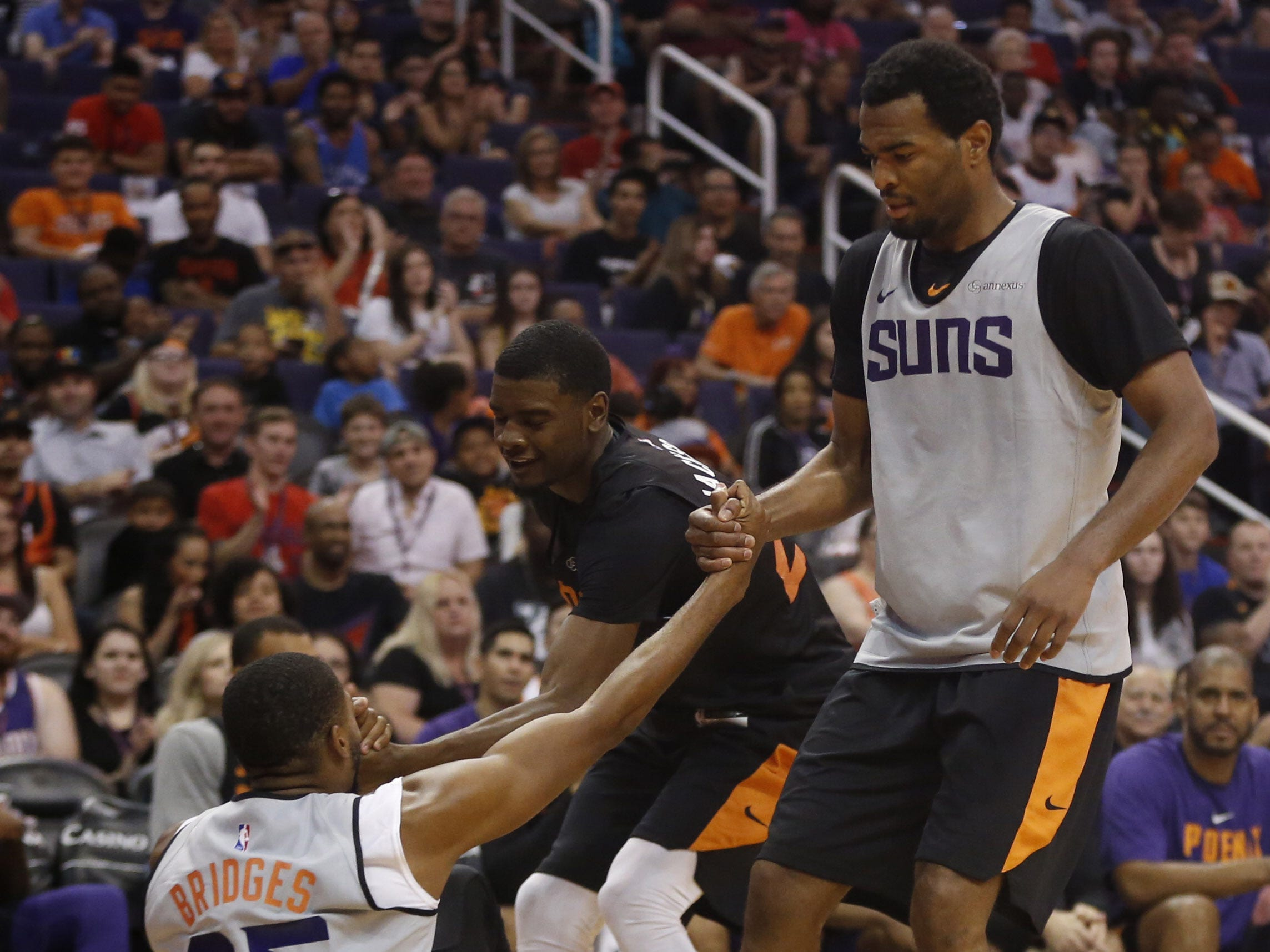 Suns TJ Warren and Josh Jackson pick up teammate Mikal Bridges during an Open Practice at Talking Stick Resort Arena in Phoenix, Ariz. on Sept. 29, 2018.