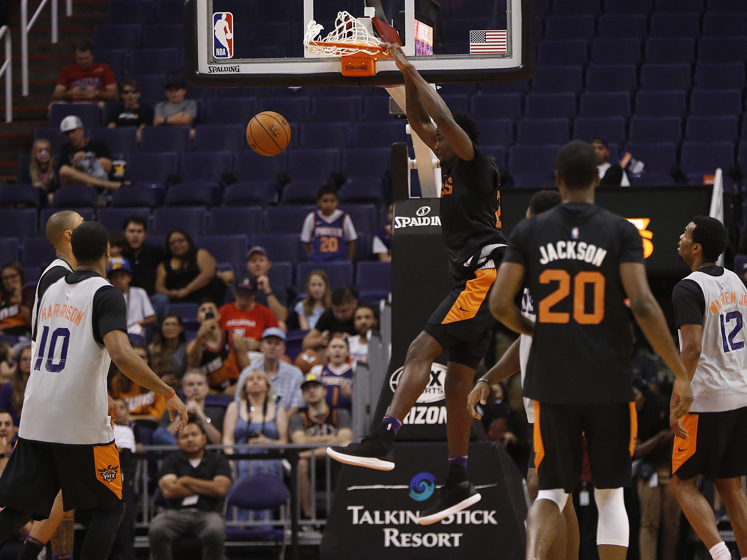 Suns Deandre Ayton dunks during an Open Practice at Talking Stick Resort Arena in Phoenix, Ariz. on Sept. 29, 2018.