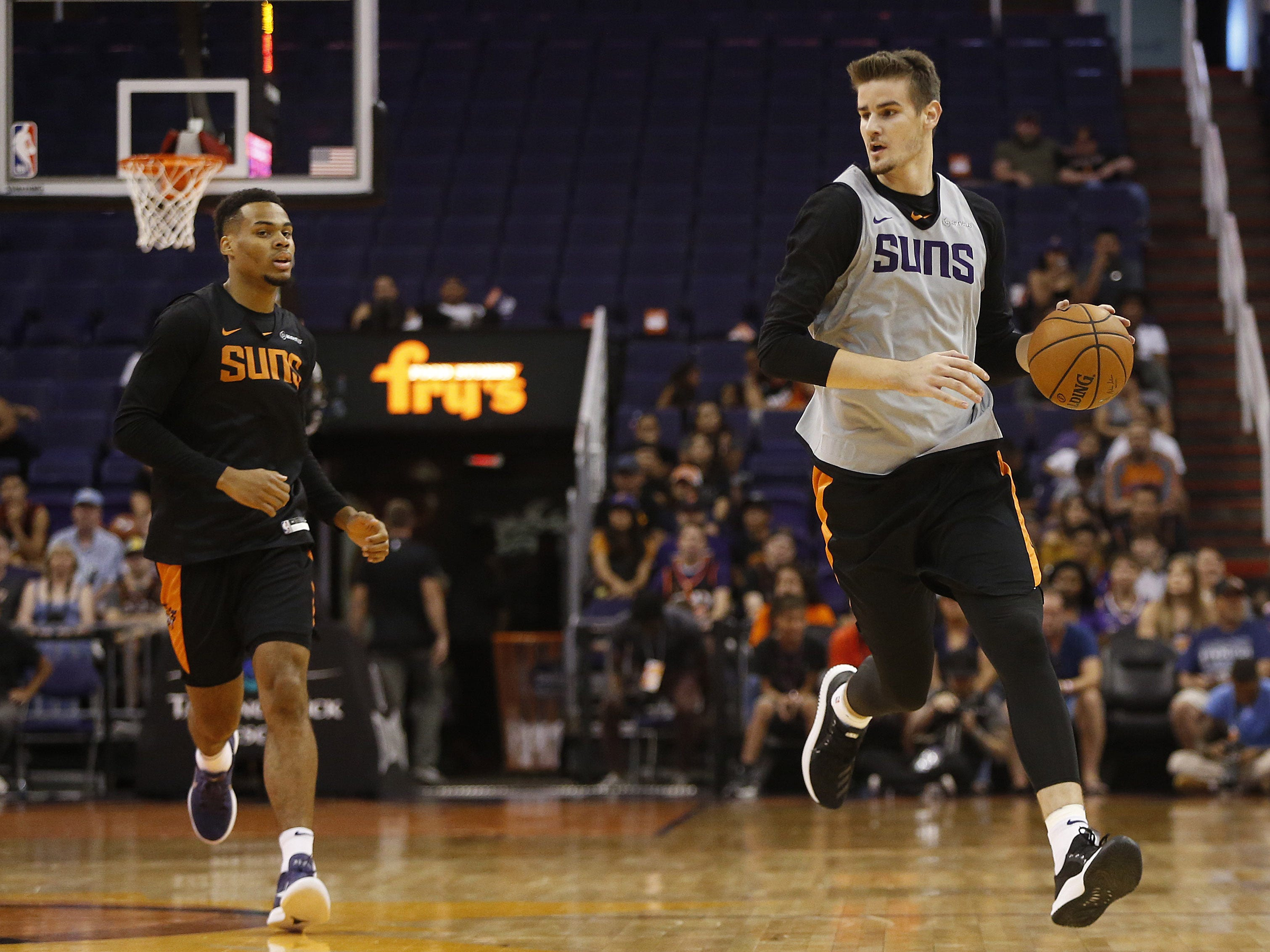 Suns Dragan Bender dribbles up court during an Open Practice at Talking Stick Resort Arena in Phoenix, Ariz. on Sept. 29, 2018.