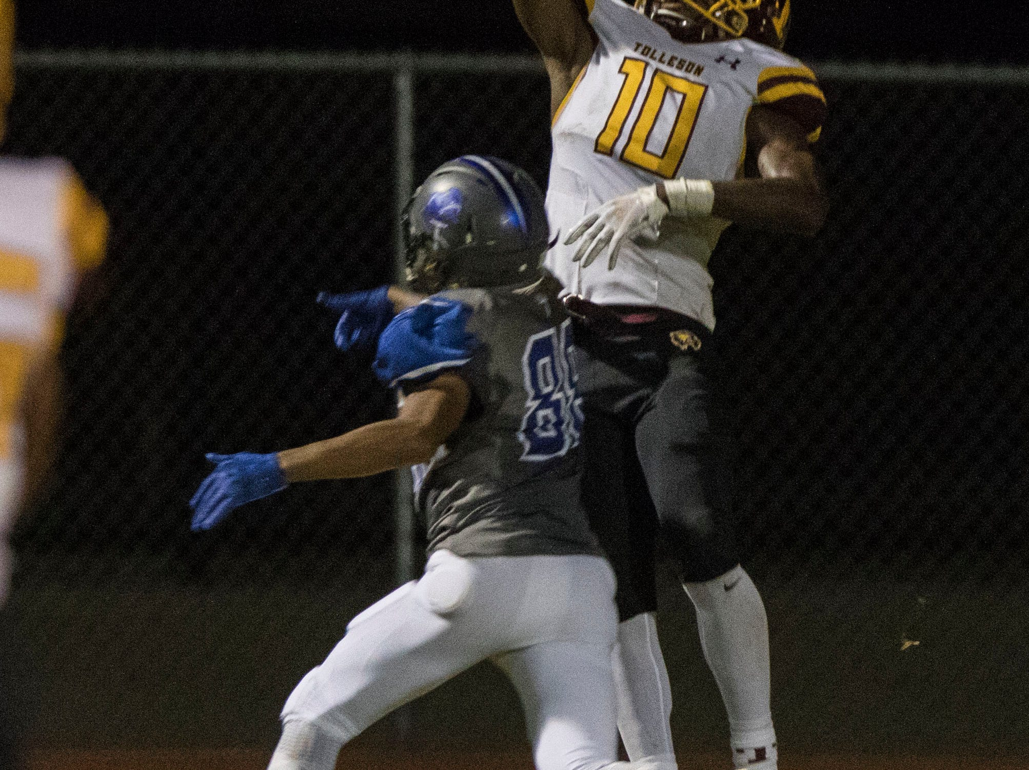 Tolleson's Andre Johnson leaps for the ball but couldn't come down with it against Westview's DHayven Valentine in Avondale Friday, Sept. 28, 2018. #azhsfb