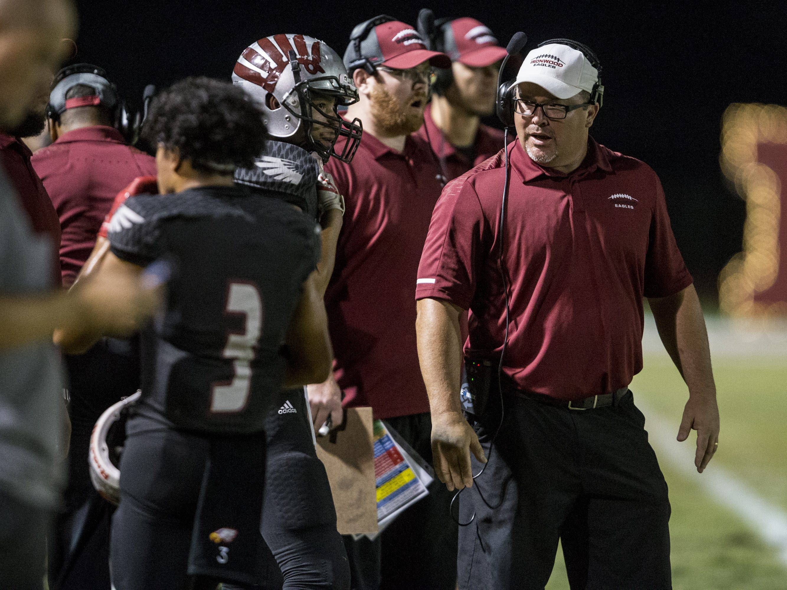 Ironwood head coach Ian Curtis talks to players during the game against Sunrise Mountain on Friday, Sept. 28, 2018, at Ironwood High School in Glendale, Ariz.  #azhsfb
