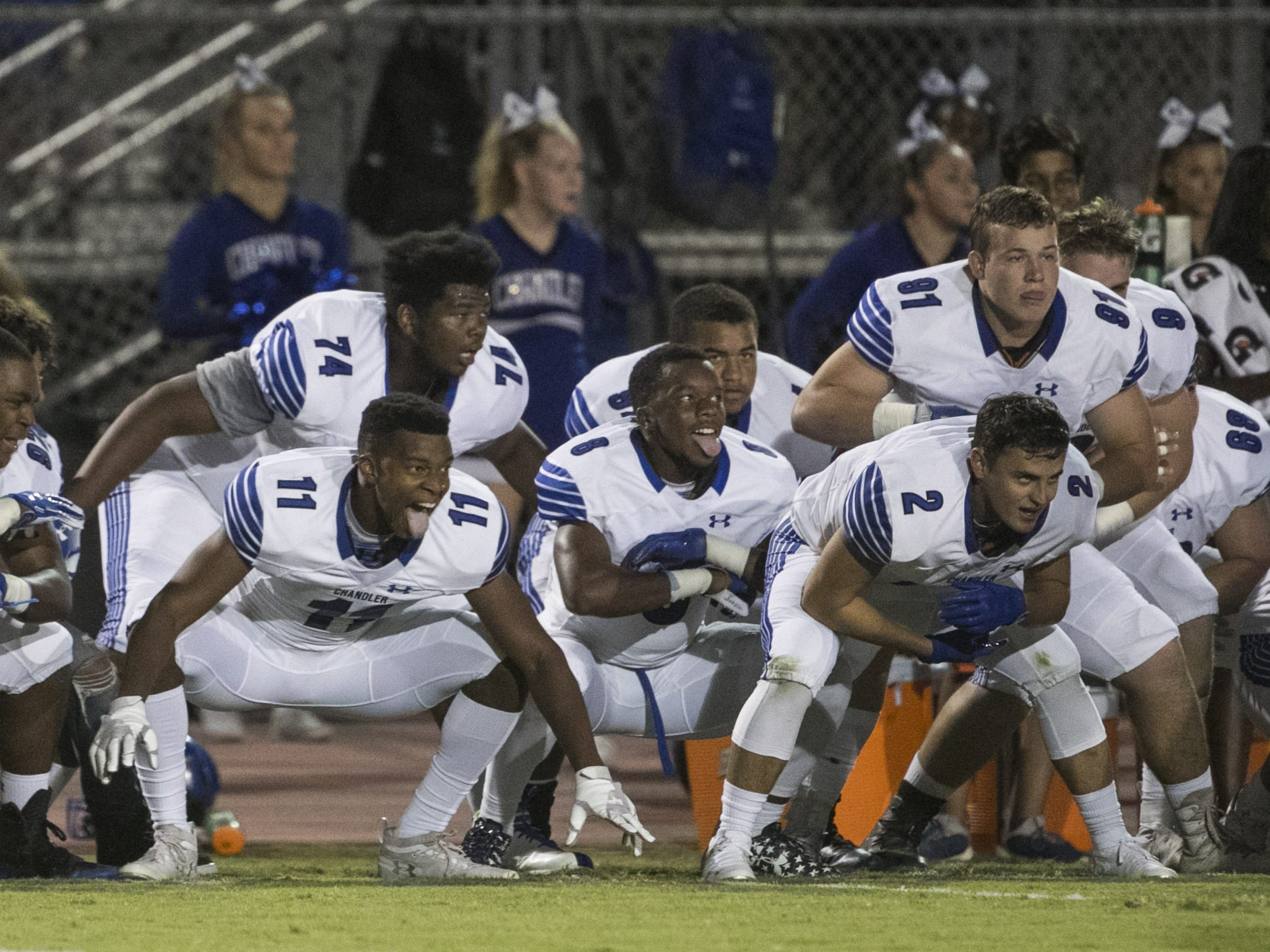 Chandler's Avery Carrington (11) sticks out his tongue as the team performs a 'hake' dance before a game at Perry High School in Gilbert, Ariz. on Sept. 28, 2018.  #azhsfb