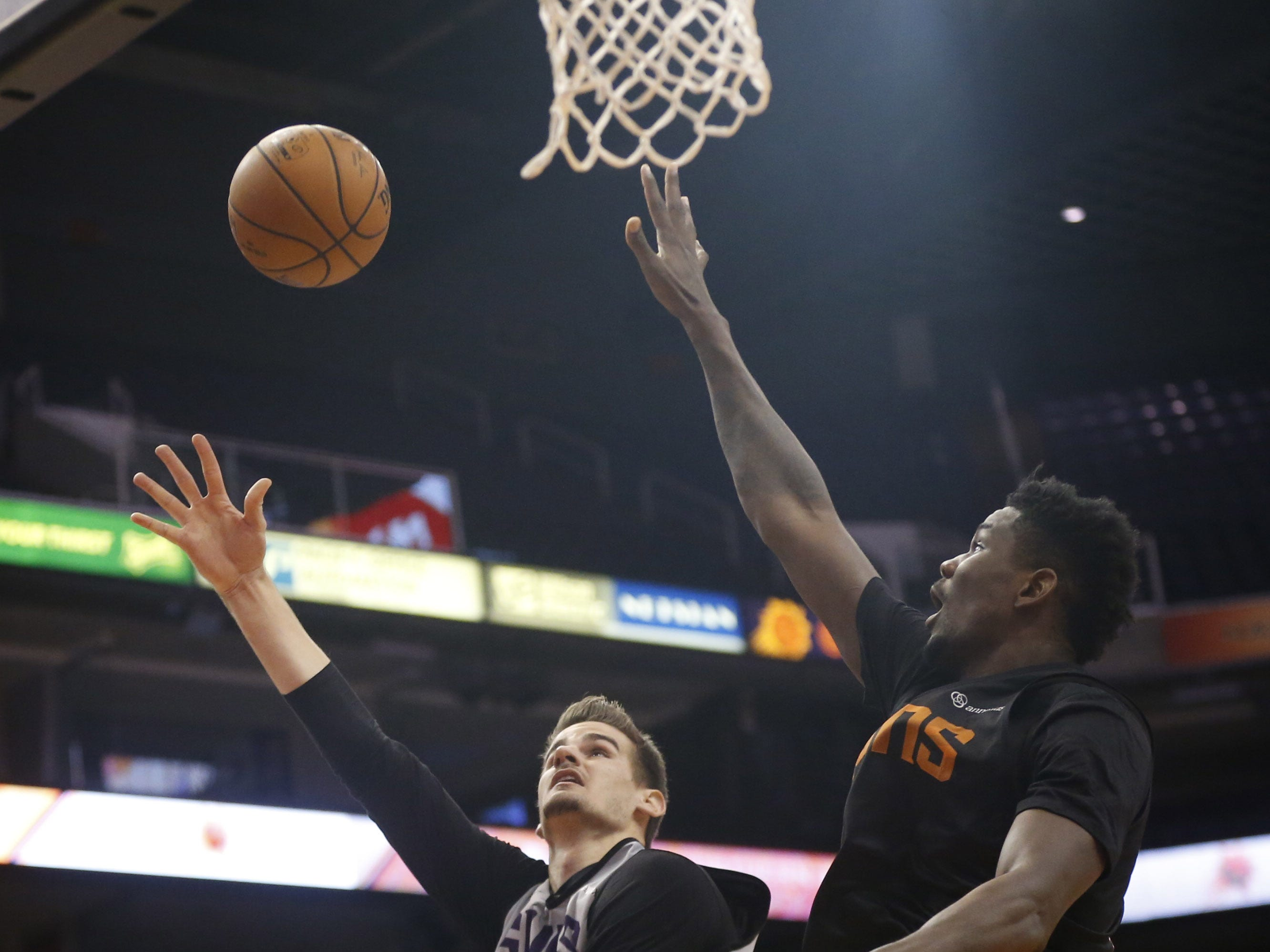 Suns Dragan Bender shoots a layup against Deandre Ayton during an Open Practice at Talking Stick Resort Arena in Phoenix, Ariz. on Sept. 29, 2018.