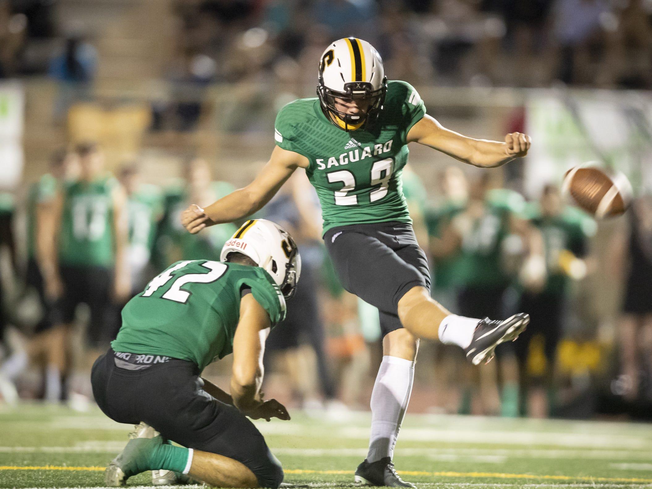 Junior kicker Parker Lewis (29) of the Saguaro Sabercats kicks an extra point against the Desert Edge Scorpions at Saguaro High School on Friday, September 28, 2018 in Scottsdale, Arizona. #azhsfb
