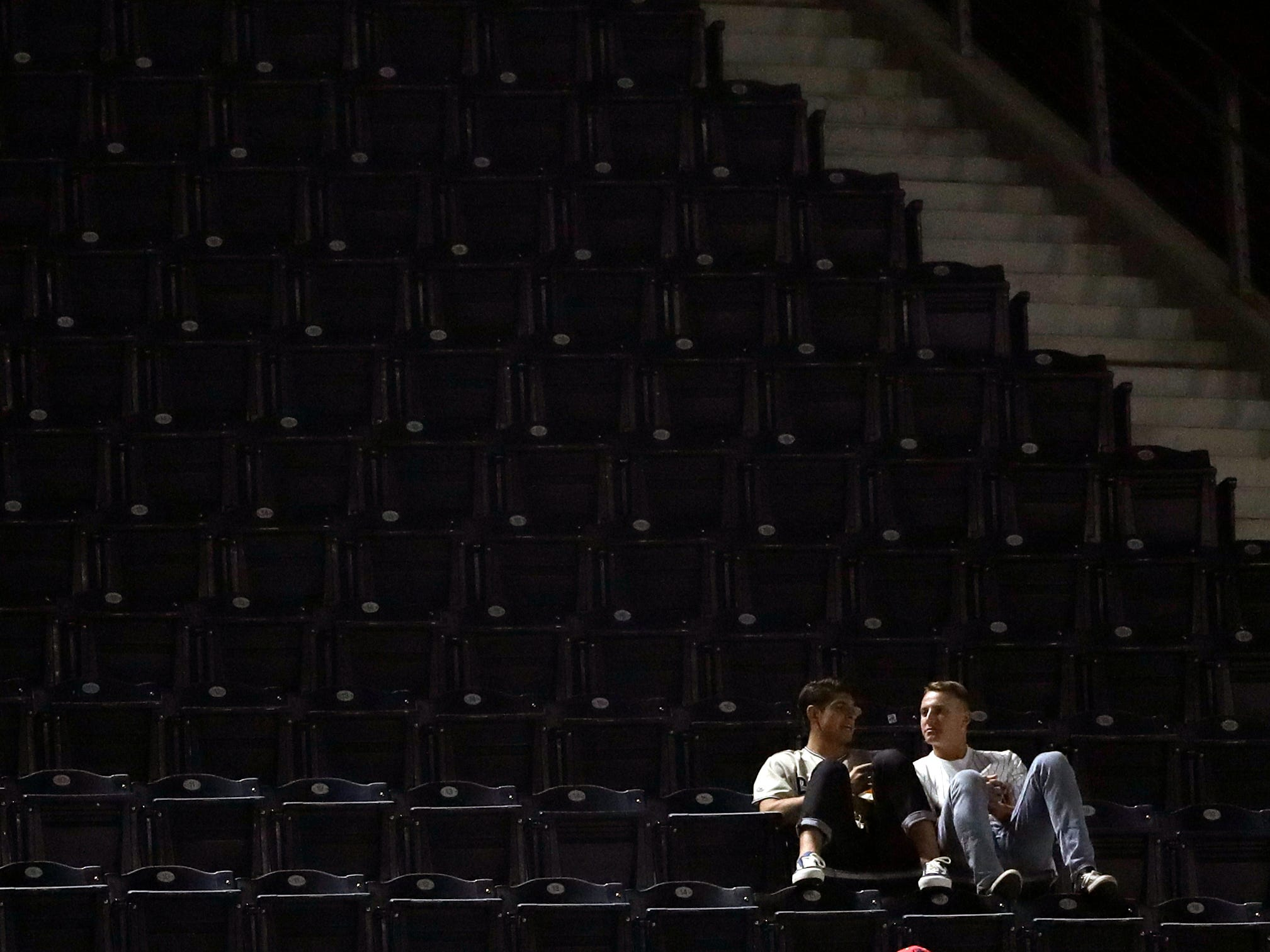 Two fans sit in otherwise empty stands as the San Diego Padres play the Arizona Diamondbacks in a baseball game Friday, Sept. 28, 2018, in San Diego. (AP Photo/Gregory Bull)