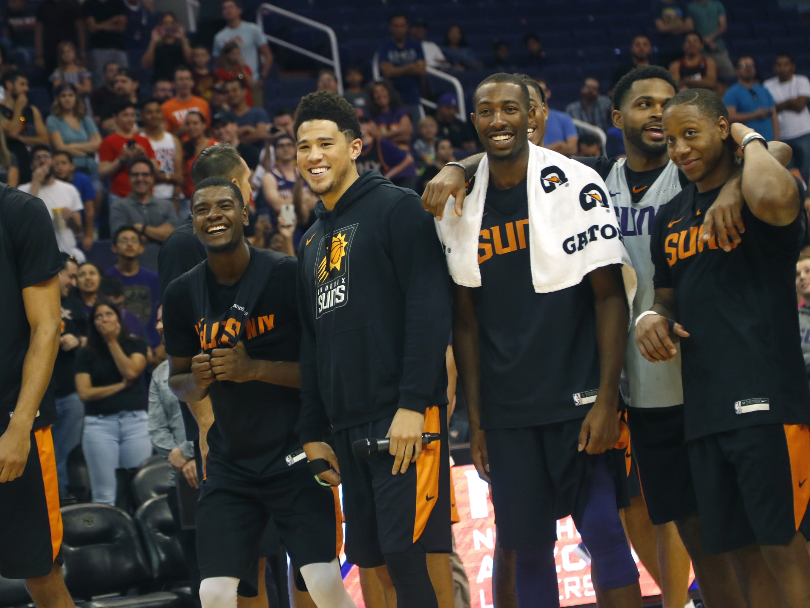 Suns players react as rookies wear costumes and dance during an Open Practice at Talking Stick Resort Arena in Phoenix, Ariz. on Sept. 29, 2018.
