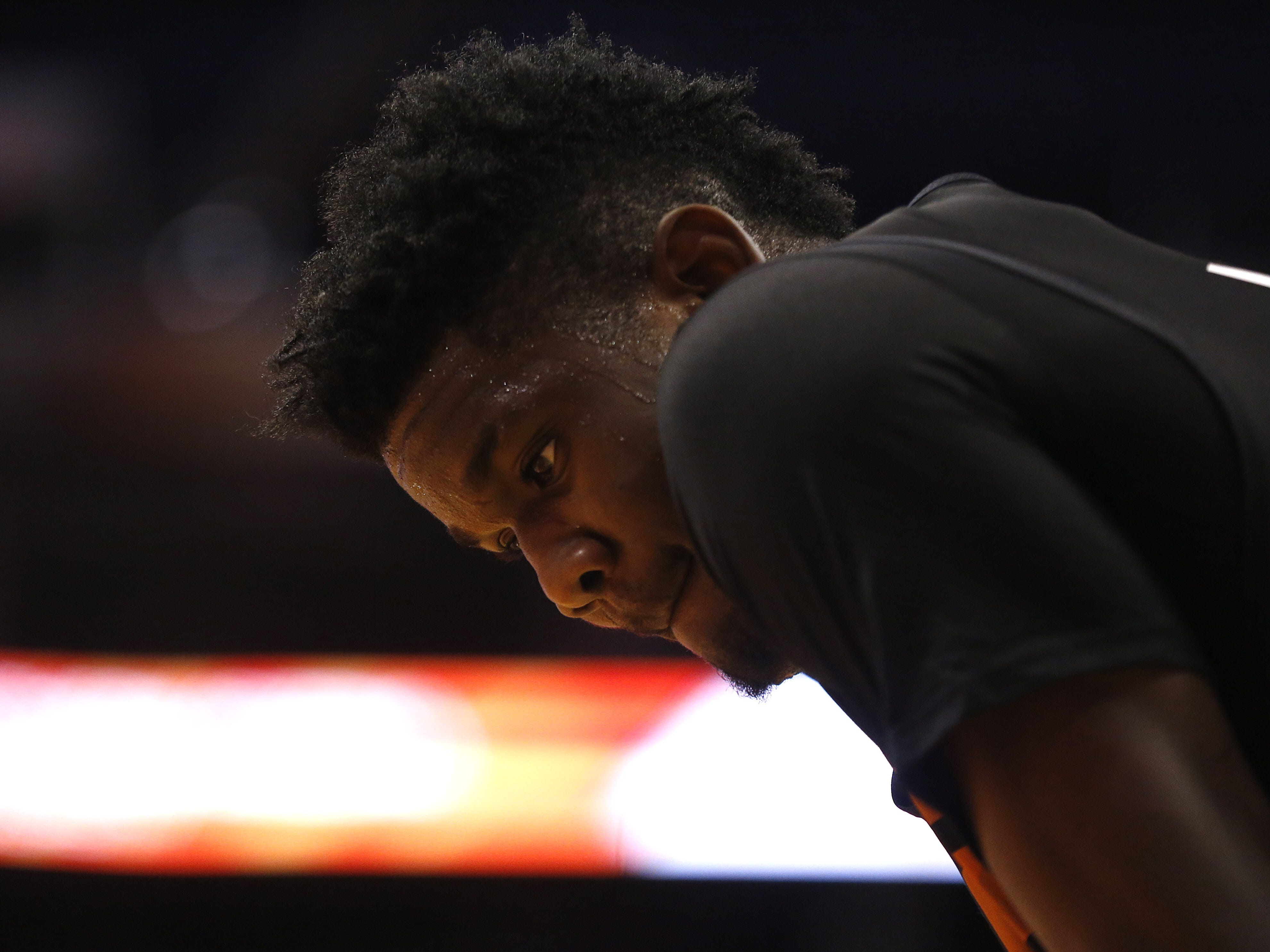 Suns Deandre Ayton looks at the court during an Open Practice at Talking Stick Resort Arena in Phoenix, Ariz. on Sept. 29, 2018.