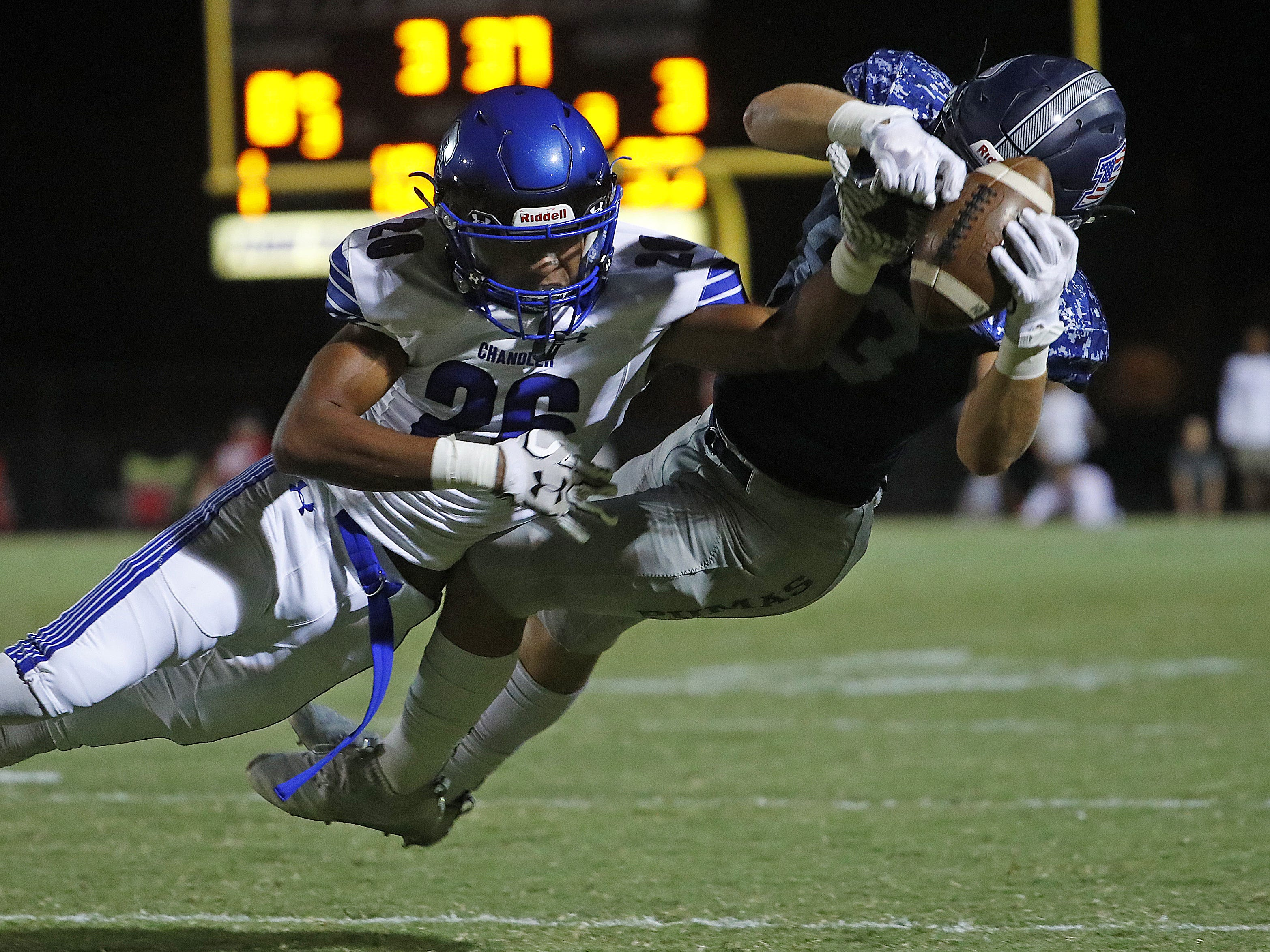 Chandler's Andrew Kirk (26) breaks up a pass intended for Perry's Connor Boyd (83) at Perry High School in Gilbert, Ariz. on Sept. 28, 2018.  #azhsfb
