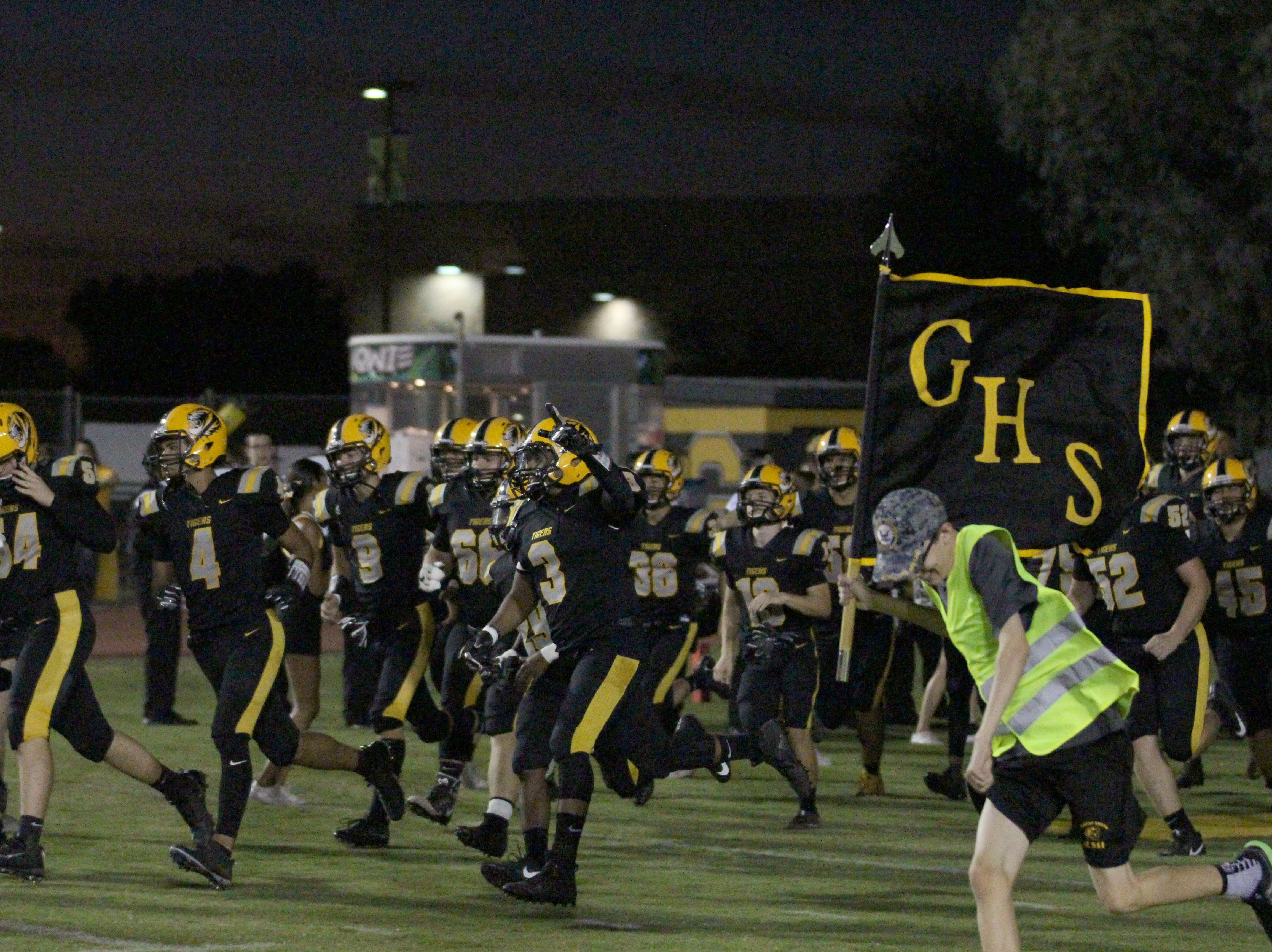 Gilbert runs onto the field before its game against Williams Field on Friday night at Gilbert High School on Sept. 28, 2018.