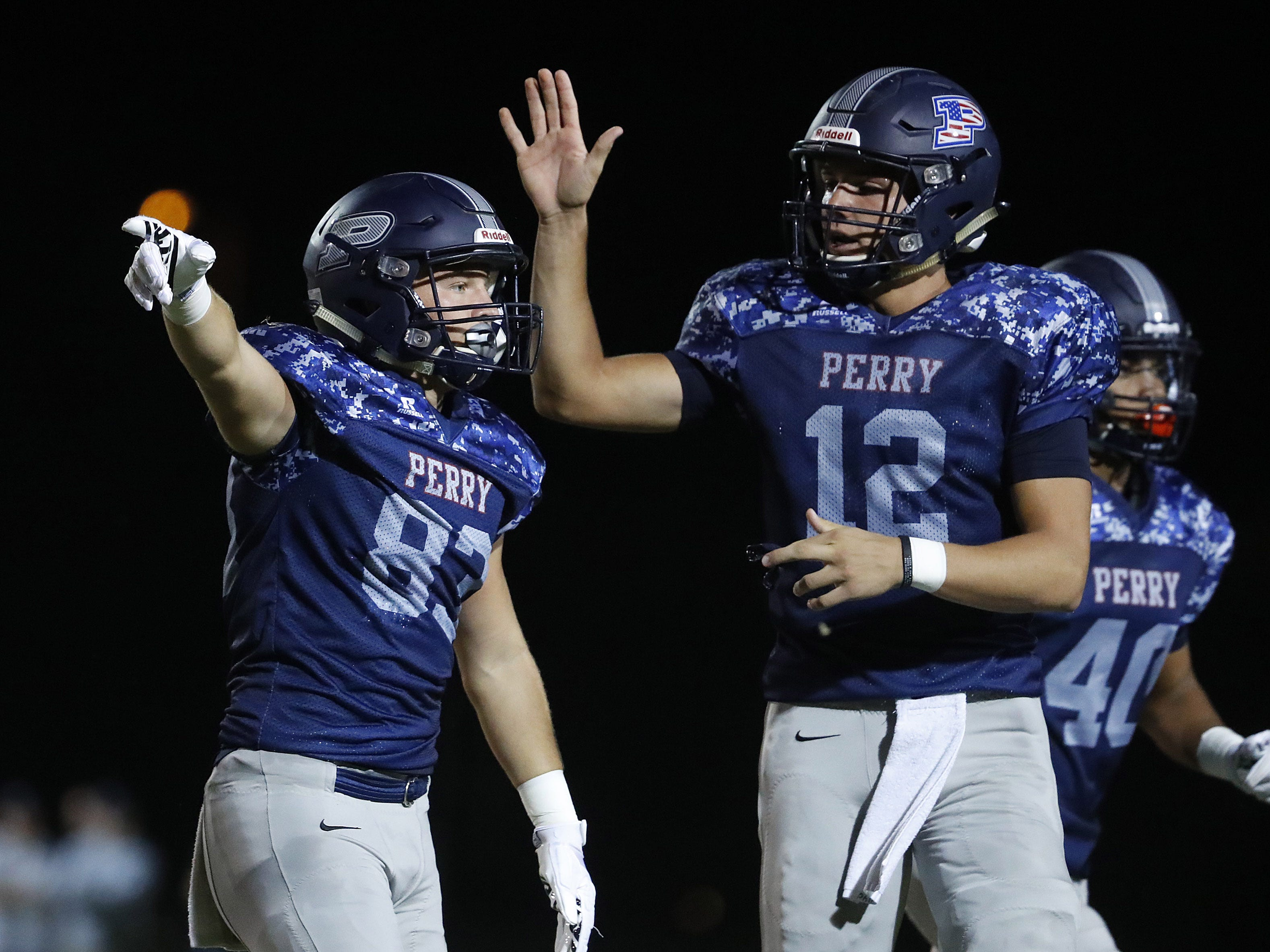 Perry's Connor Boyd (83) celebrates a first down with quarterback Chubba Purdy (12) at Perry High School in Gilbert, Ariz. on Sept. 28, 2018.  #azhsfb