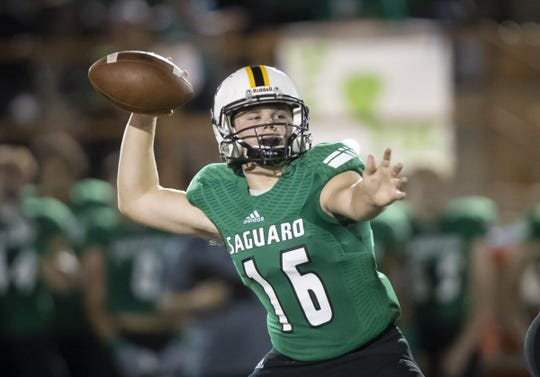 Sophomore quarterback Frank Schafroth (16) of the Saguaro Sabercats throws a pass against the Desert Edge Scorpions at Saguaro High School on Friday, September 28, 2018 in Scottsdale, Arizona. #azhsfb