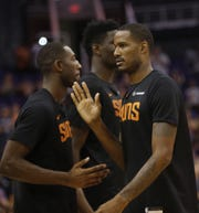 Suns Trevor Ariza high-fives Davon Reed during an Open Practice at Talking Stick Resort Arena in Phoenix, Ariz. on Sept. 29, 2018.