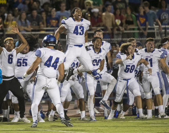 Chandler's Javan Ah Quin (43) sticks out his tongue and jumps as the team performs a 'hake' dance before a game at Perry High School in Gilbert, Ariz. on Sept. 28, 2018.  #azhsfb
