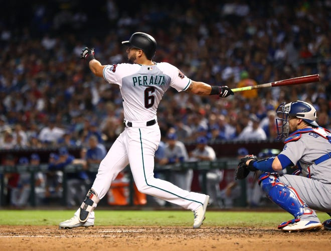 Sep 25, 2018: Arizona Diamondbacks outfielder David Peralta hits a two run double against the Los Angeles Dodgers in the sixth inning at Chase Field.