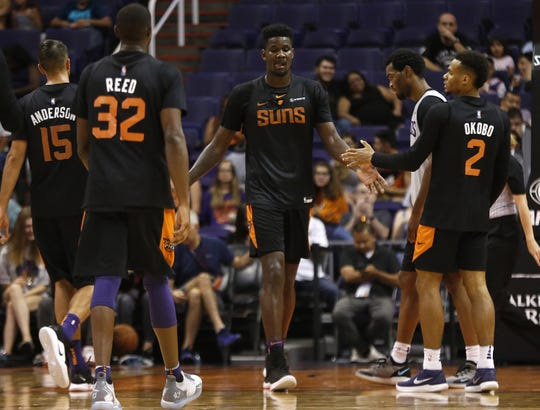 Suns Deandre Ayton high-fives teammates after scoring and drawing a foul during an Open Practice at Talking Stick Resort Arena in Phoenix, Ariz. on Sept. 29, 2018.