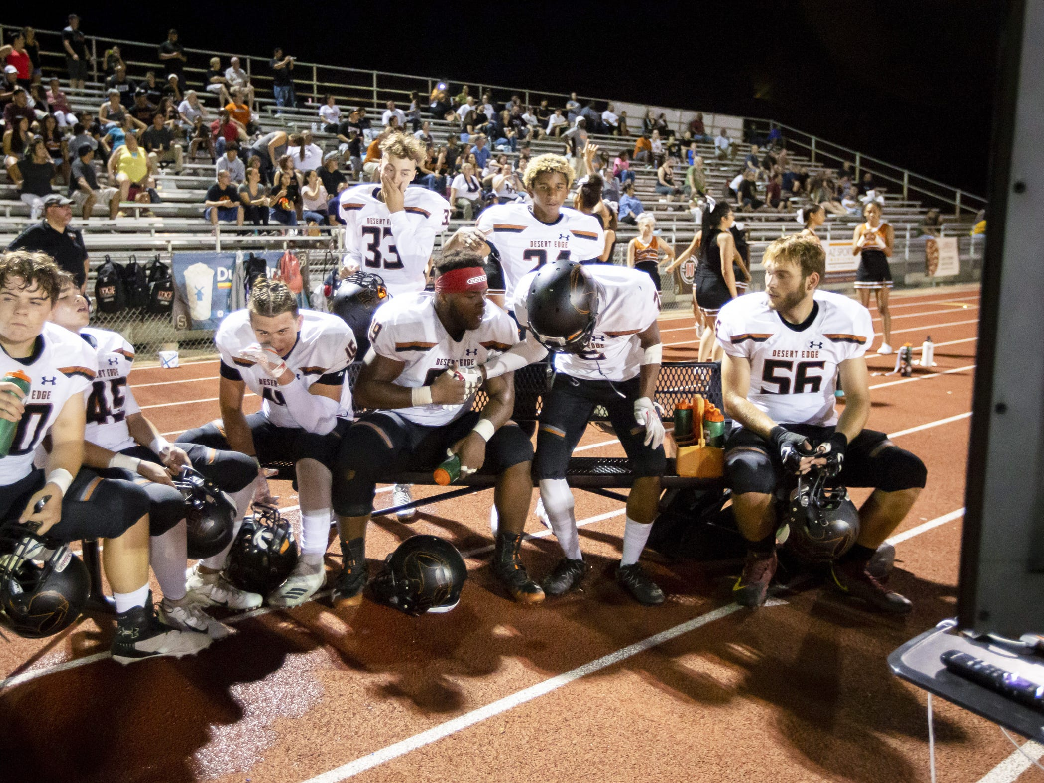 The Desert Edge Scorpions review a play against the Saguaro Sabercats at Saguaro High School on Friday, September 28, 2018 in Scottsdale, Arizona. #azhsfb