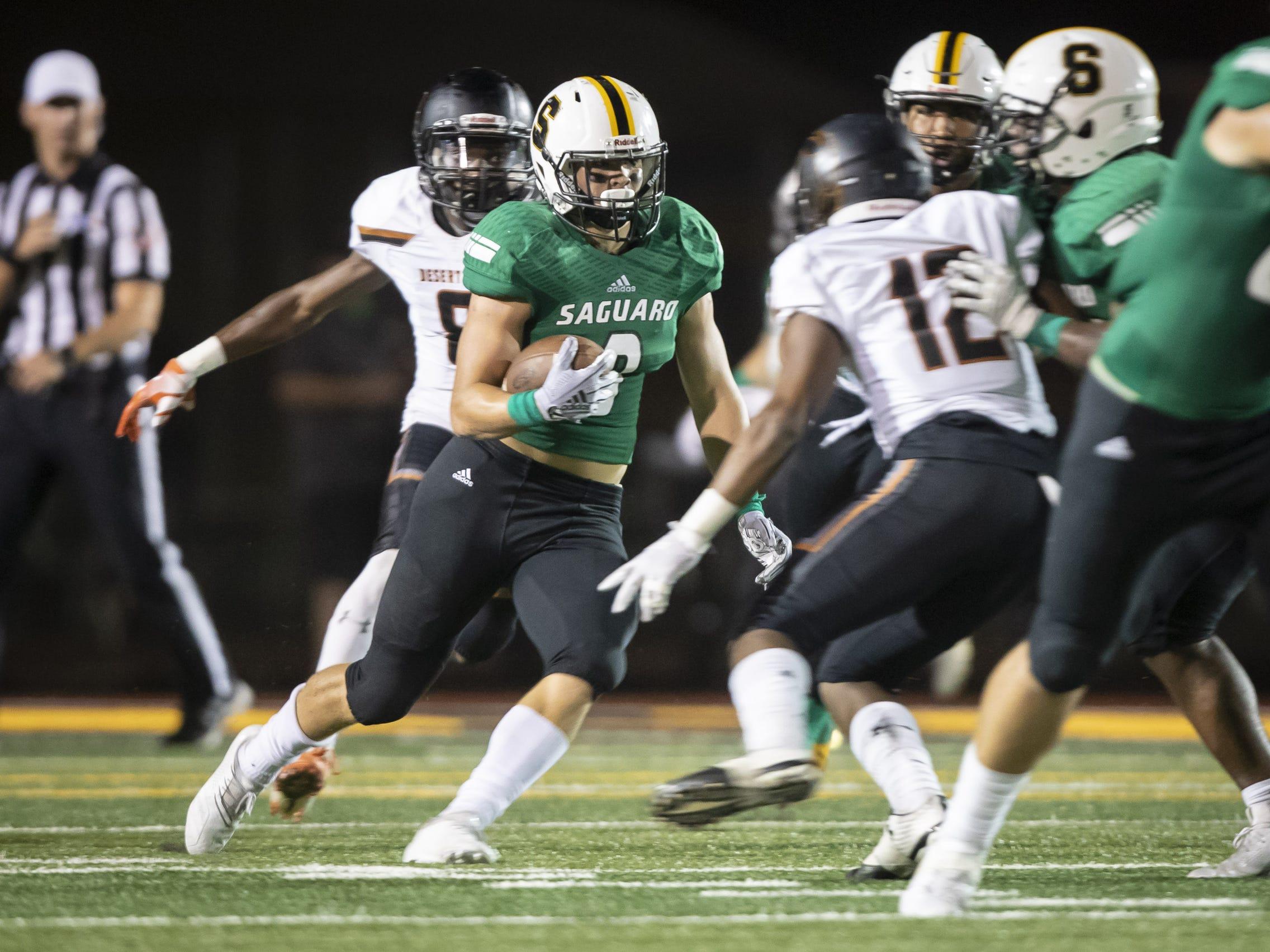 Sophomore quarterback Frank Schafroth (16) of the Saguaro Sabercats runs the ball against the Desert Edge Scorpions at Saguaro High School on Friday, September 28, 2018 in Scottsdale, Arizona. #azhsfb