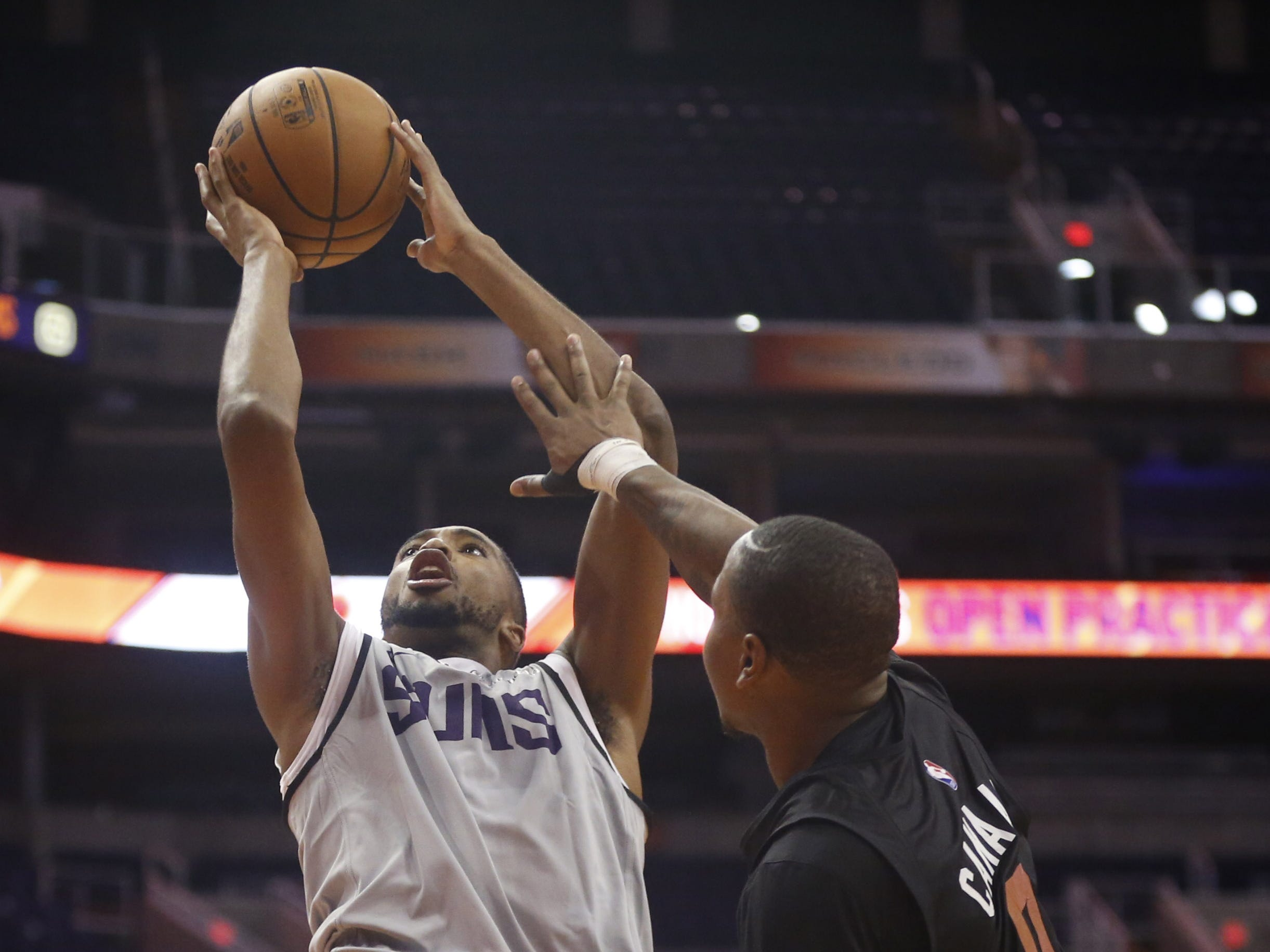 Suns Mikal Bridges shoots over Isaiah Canaan during an Open Practice at Talking Stick Resort Arena in Phoenix, Ariz. on Sept. 29, 2018.