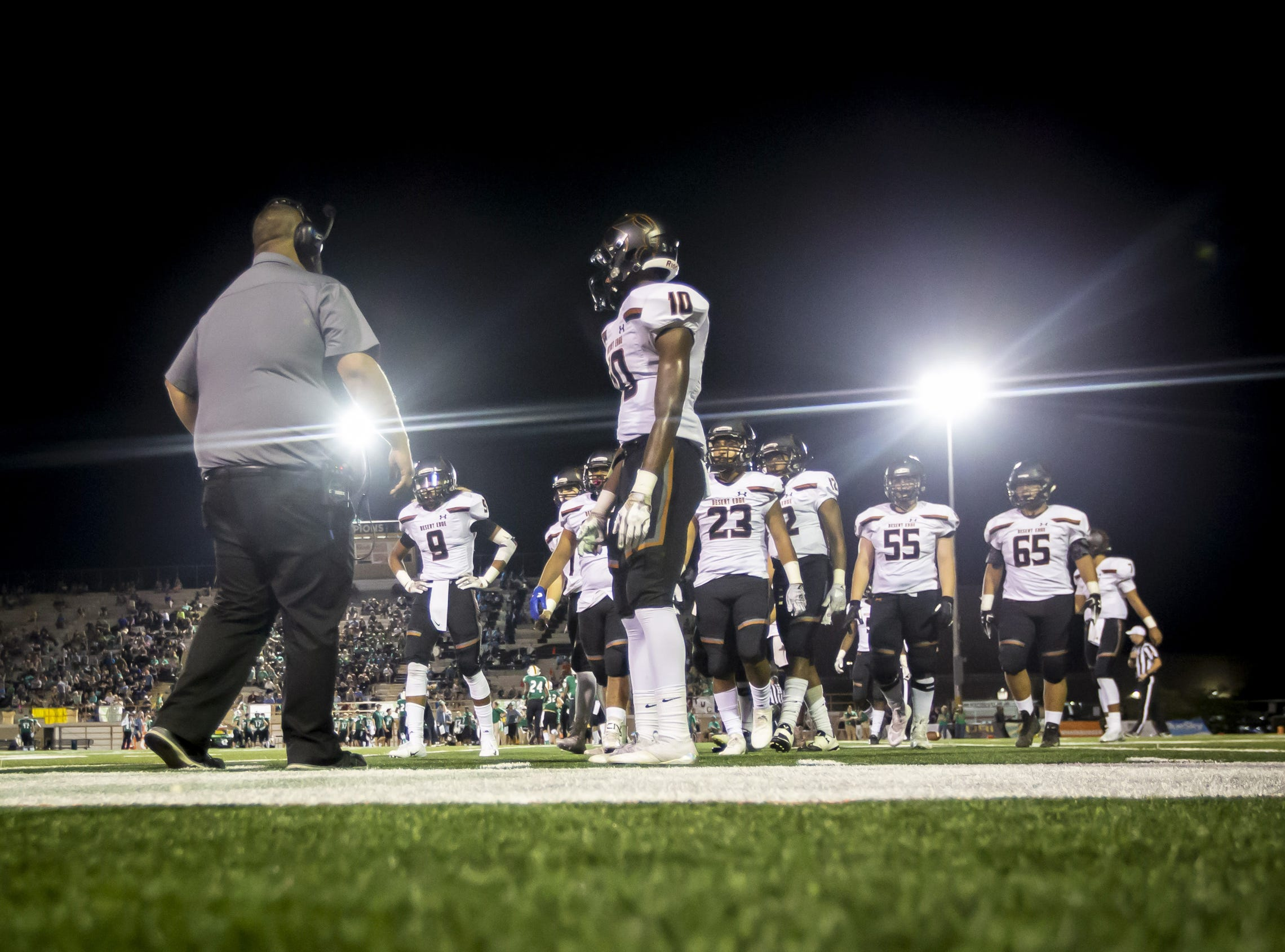 The Desert Edge Scorpions walk off the field following a play against the Saguaro Sabercats at Saguaro High School on Friday, September 28, 2018 in Scottsdale, Arizona. #azhsfb