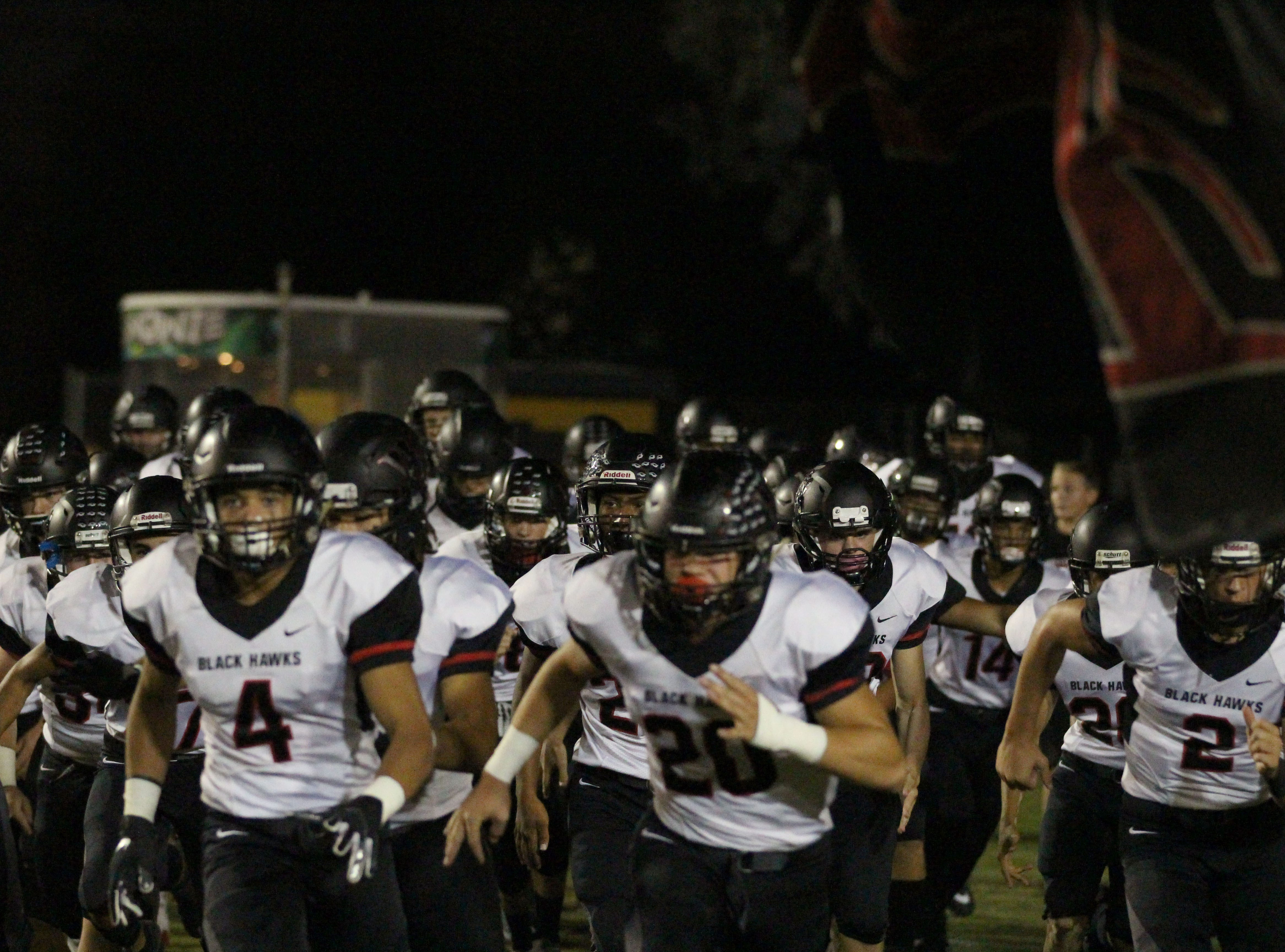 Williams Field runs onto the field before its game against Gilbert on Friday night at Gilbert High School on Sept. 28, 2018.